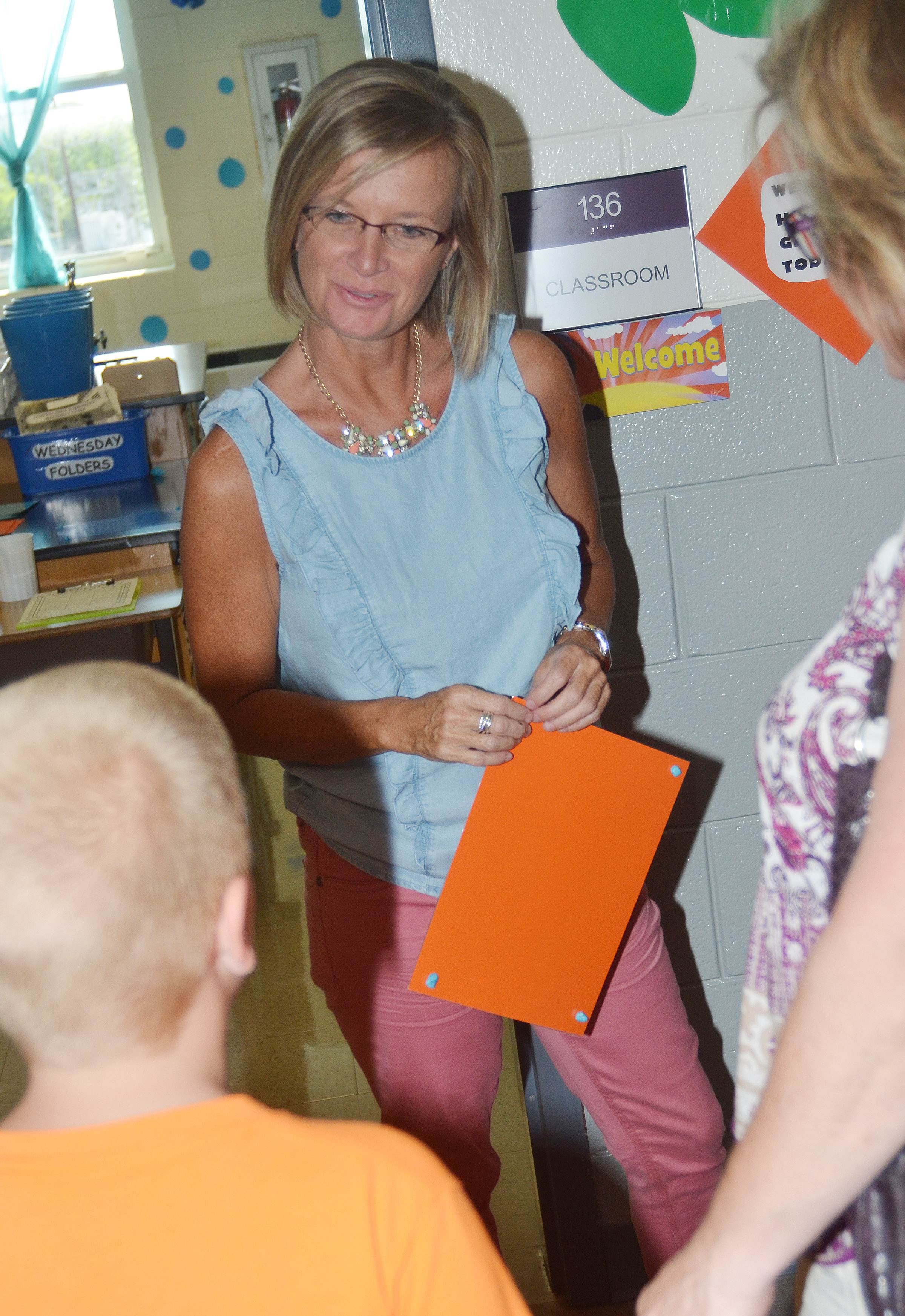 CES teacher Melanie Cox talks to one of her new second-grade students.