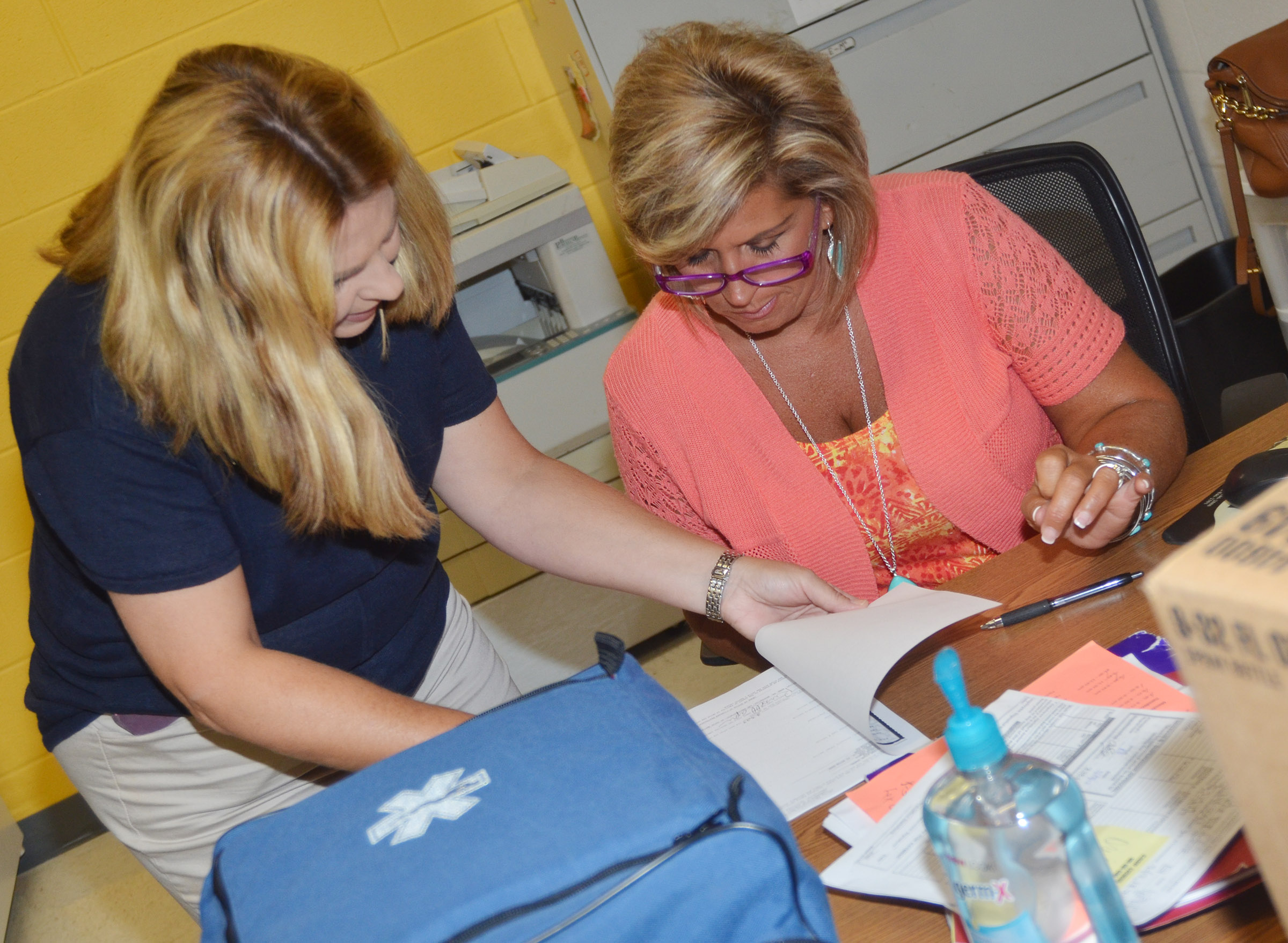 CES Guidance Counselor Sonya Orberson talks to school nurse Lisa Cowherd.
