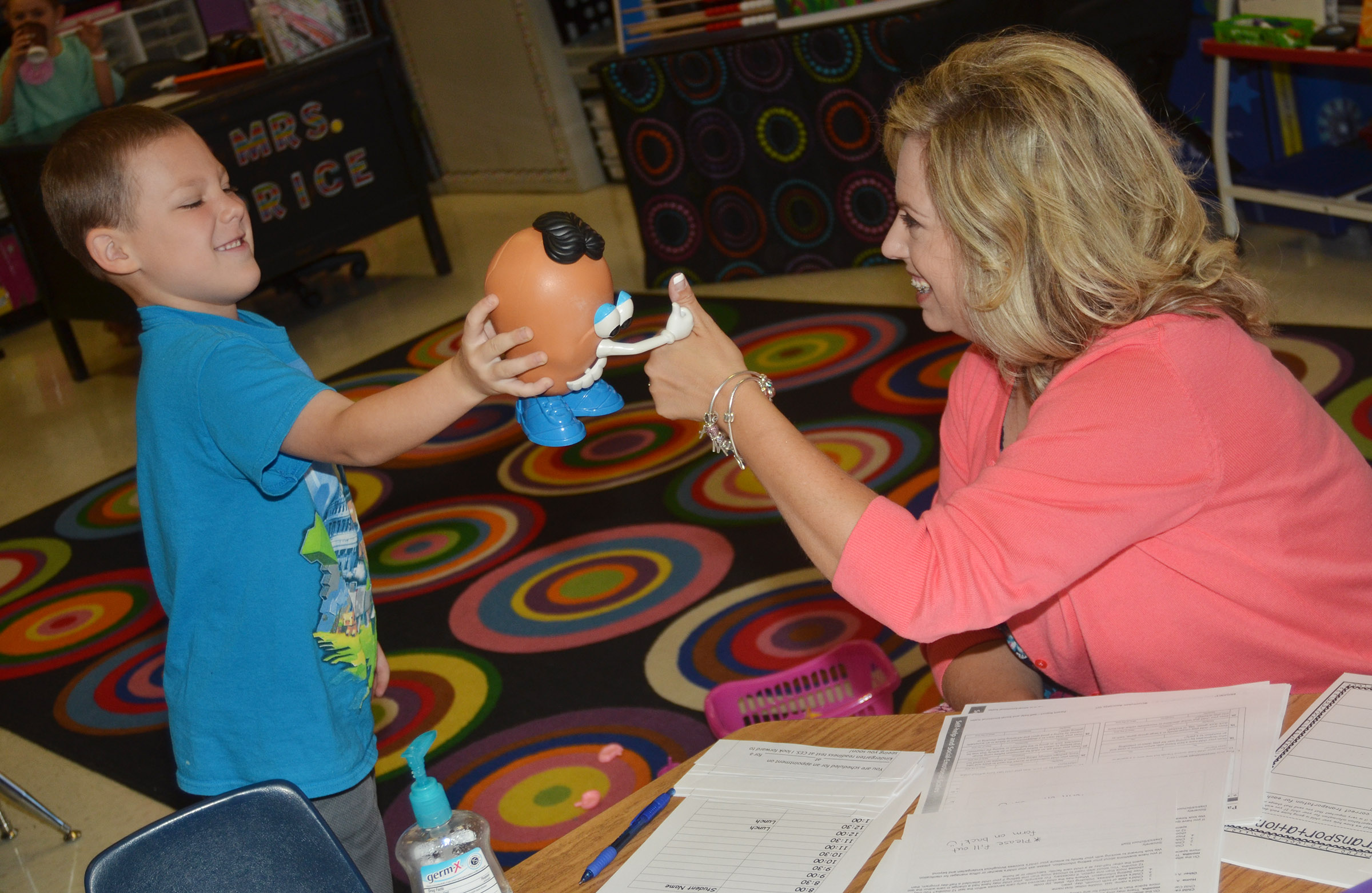 CES kindergarten teacher Nikki Price gives student Kyler Wilson a thumbs as he shows her the Mr. Potato Head he built.