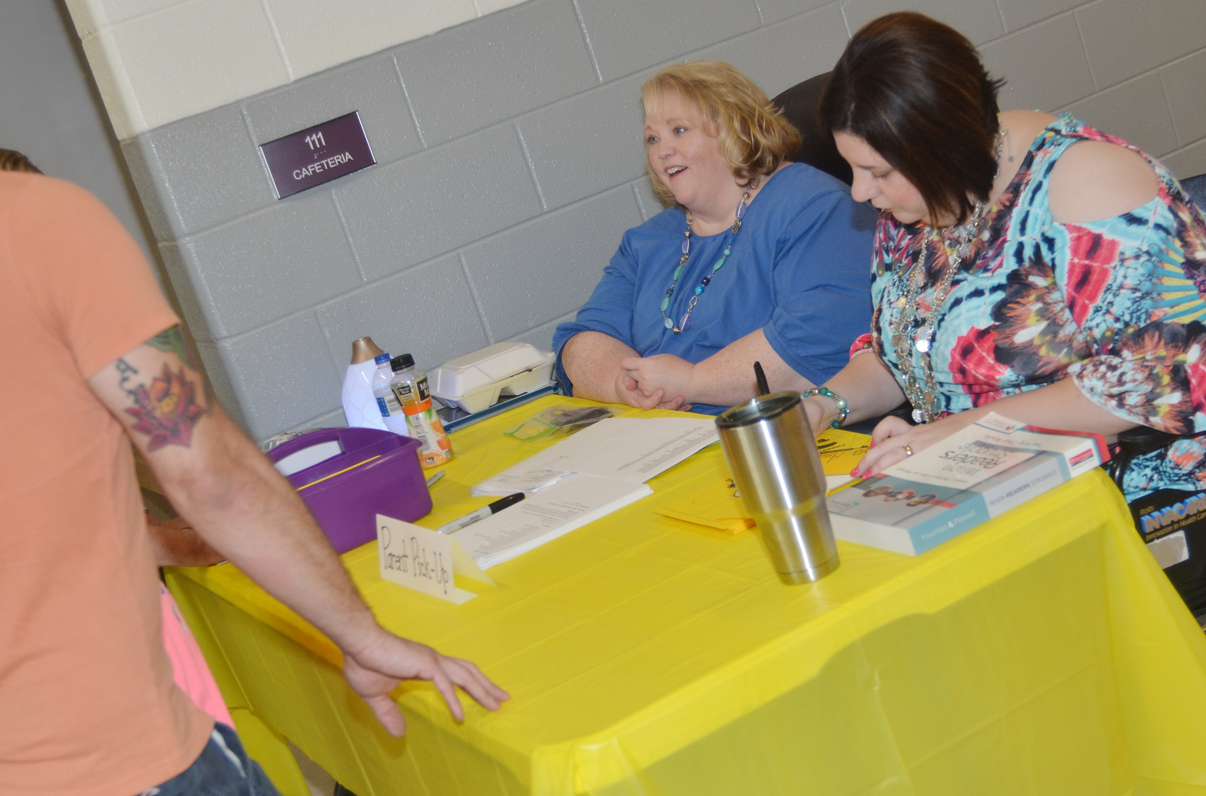 CES Media Specialist Susie Crowder, at left, and teacher Lisa Mardis issue parent pick up tags to parents.
