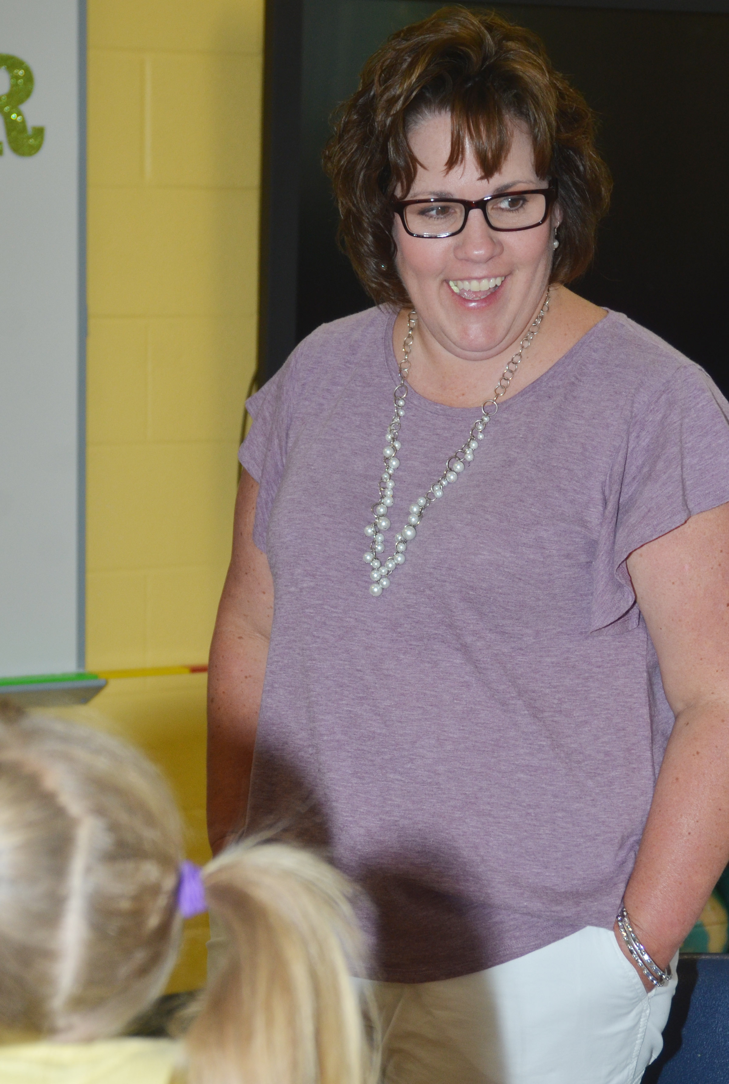 CES second-grade teacher Tracey Rinehart talks to one of her new second-grade students.