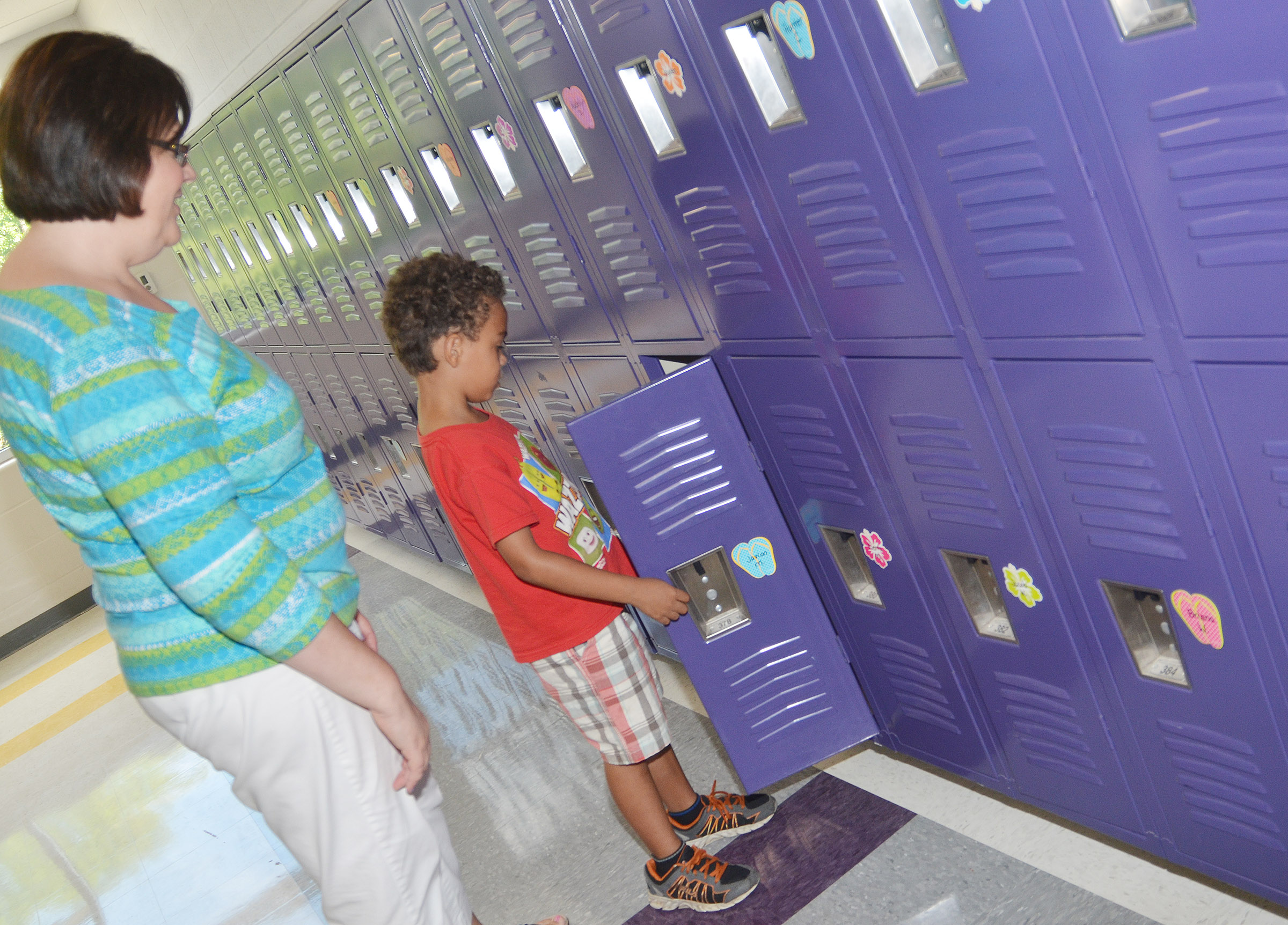 CES second-grade teacher Tonya Hagan helps her student Javion Milby find his locker.