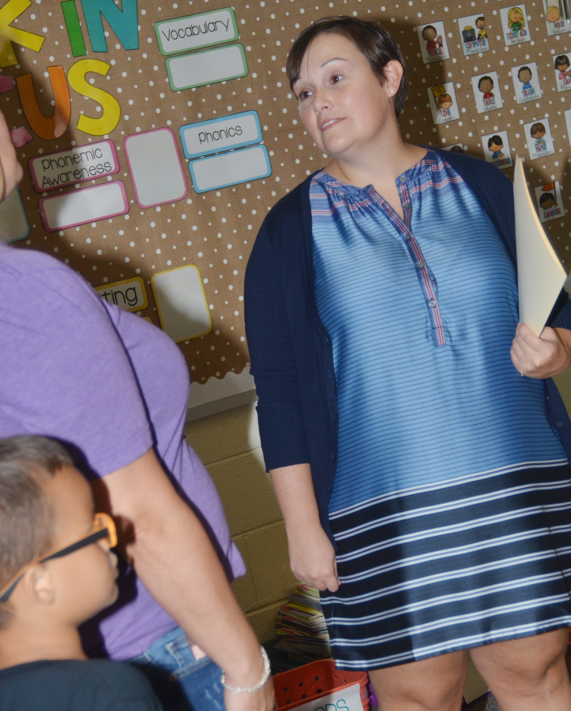 CES first-grade teacher Amanda Barnett talks to a parent.