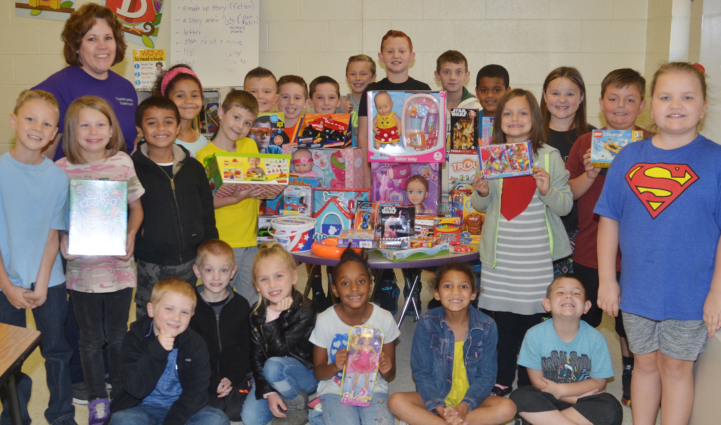 CES students recently competed to see which classroom could bring in the most toys to donate to Operation Christmas Smiles. Tracey Rinehart's second-grade students donated the most toys and will receive a Christmas pizza party.