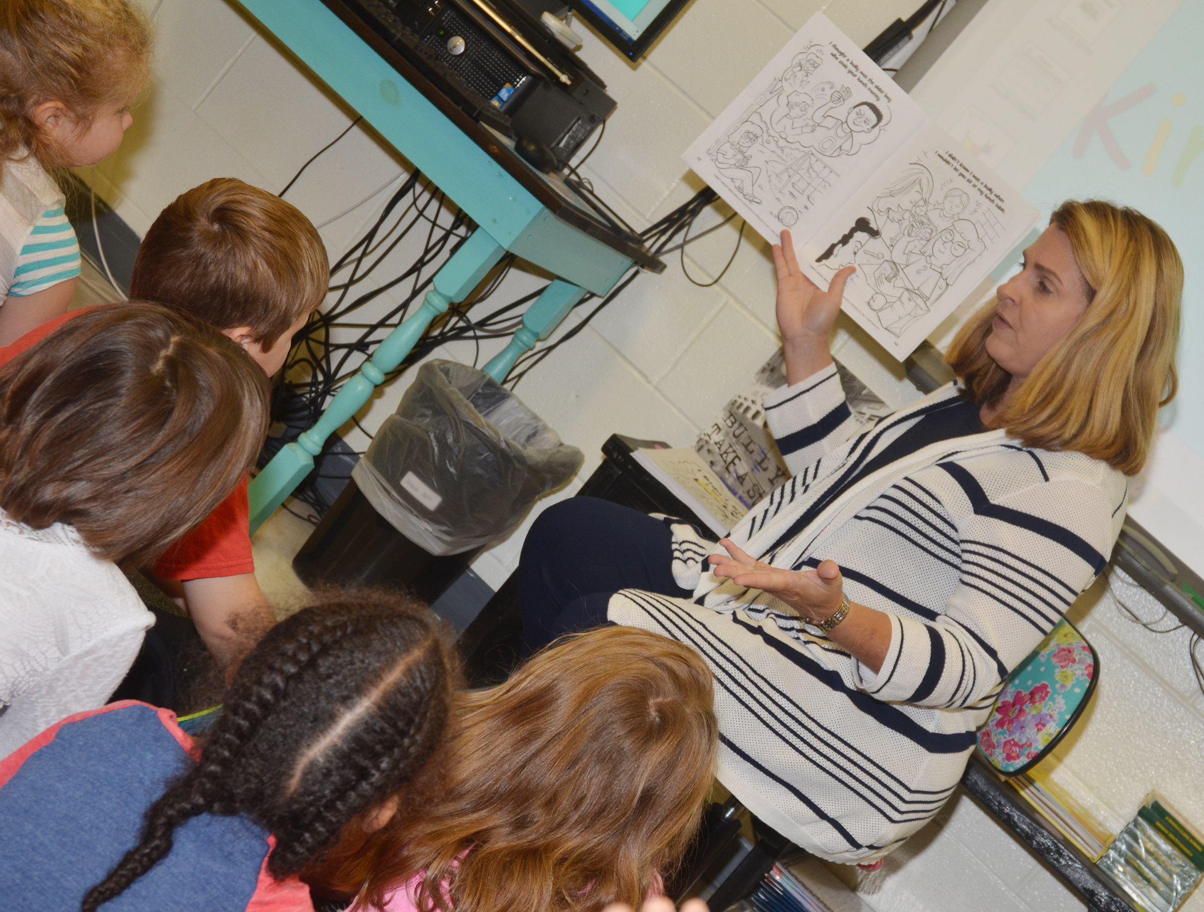 CES Guidance Counselor Sonya Orberson talks to first-grade students about bullying.