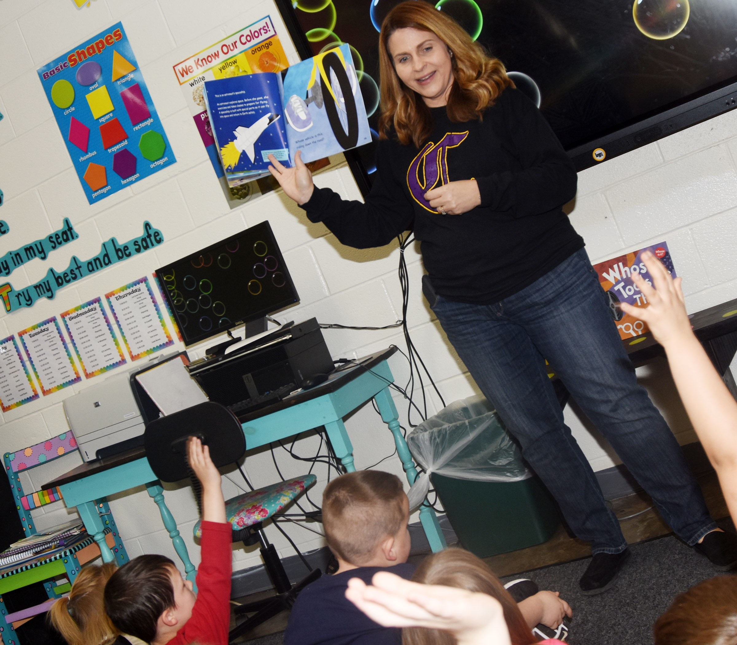 CES Guidance Counselor Sonya Orberson asks CES kindergarteners who wants to be an astronaut when they get older.