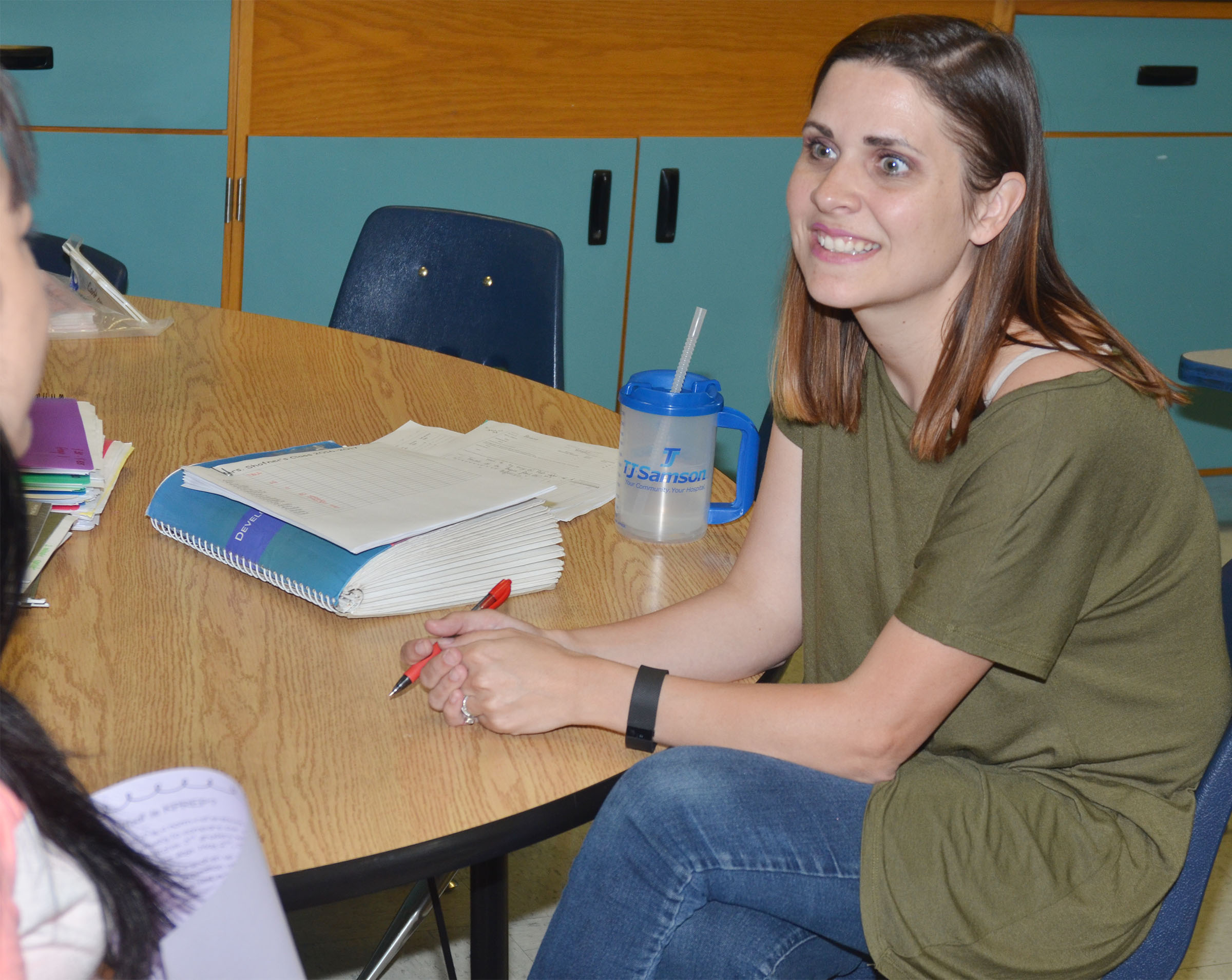 CES first-grade teacher Luci Shofner meets with a parent.