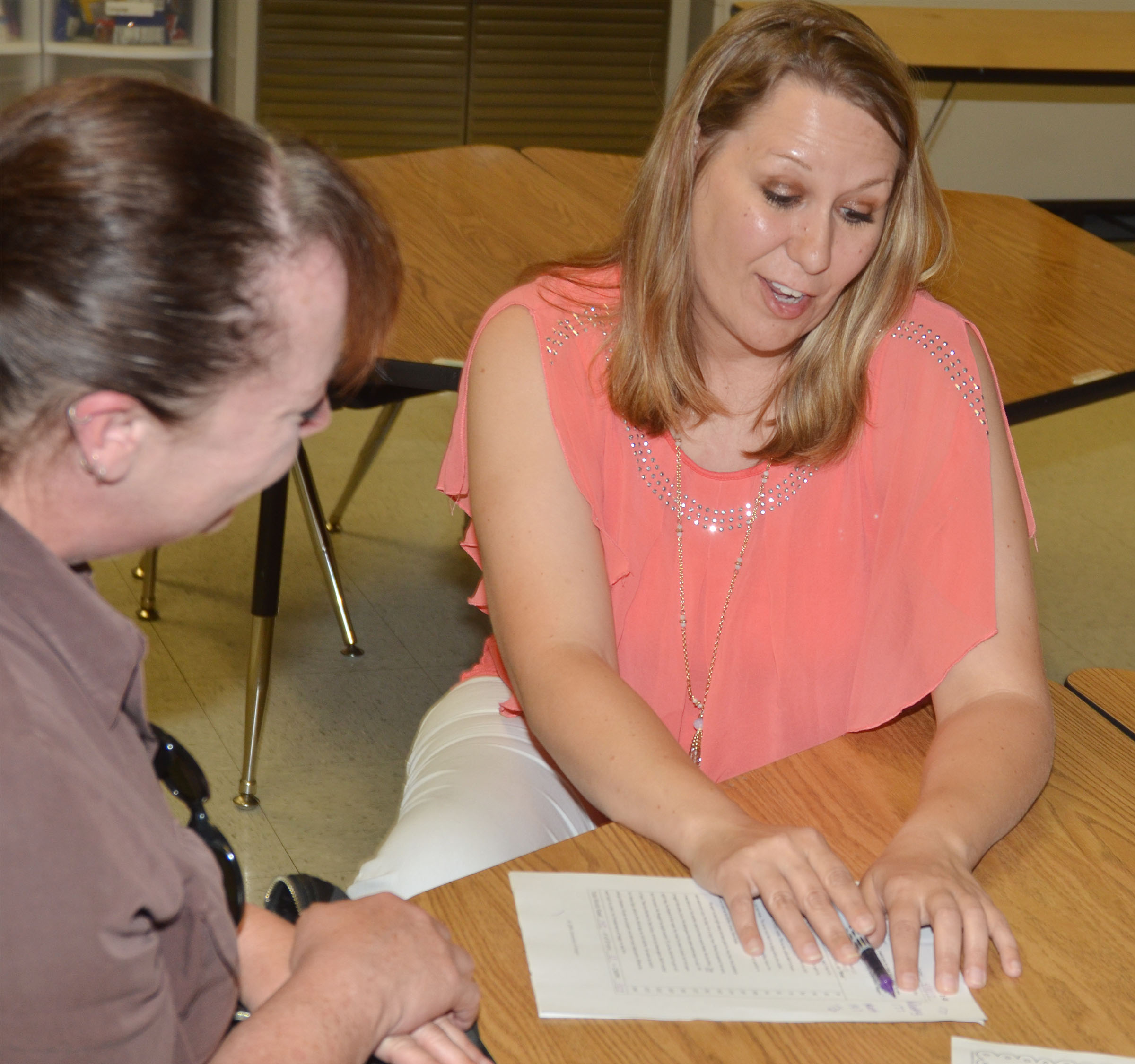 CES first-grade teacher Amanda Greer talks with a parent.