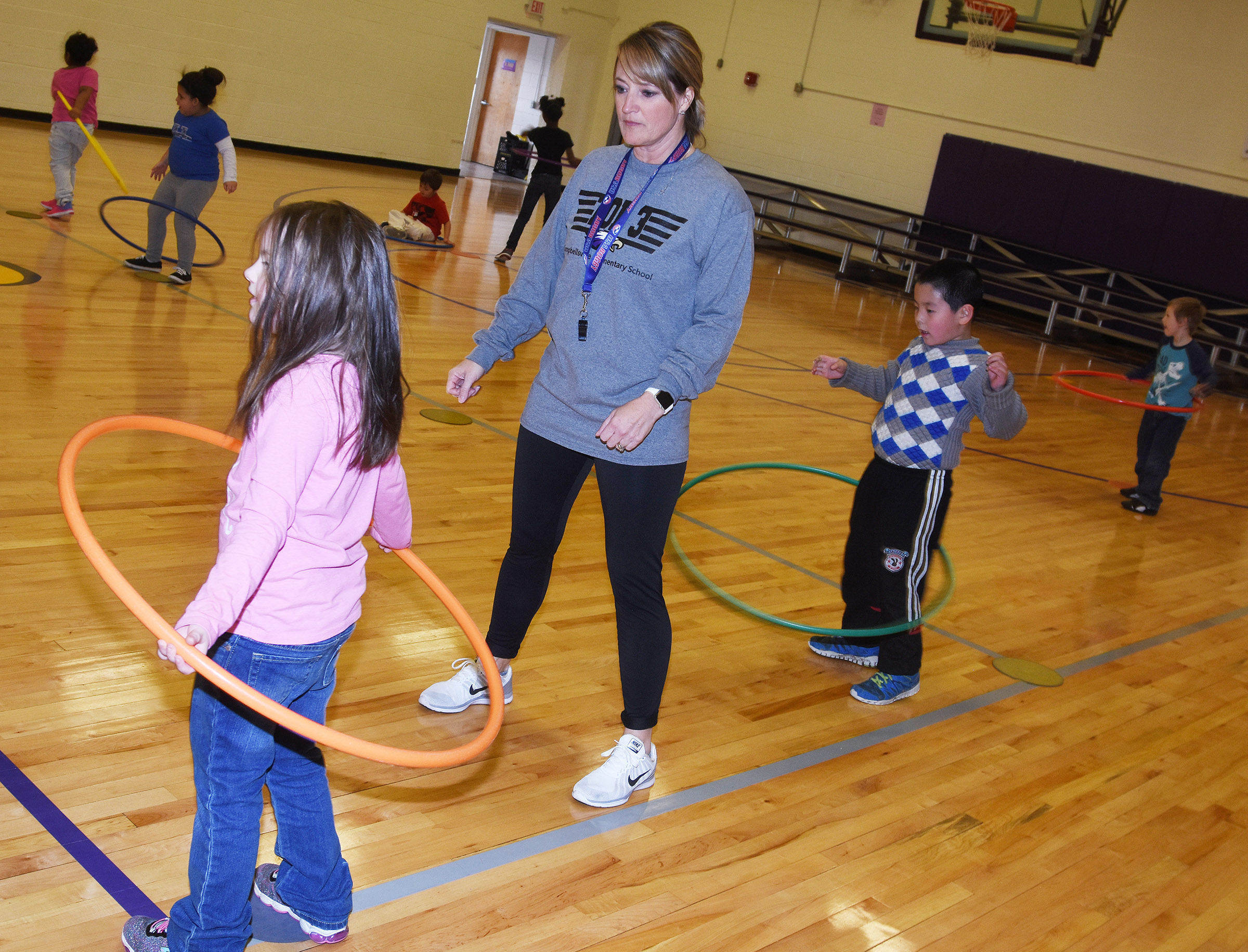 CES physical education teacher Vanessa Adkins shows kindergarteners how to hula hoop.