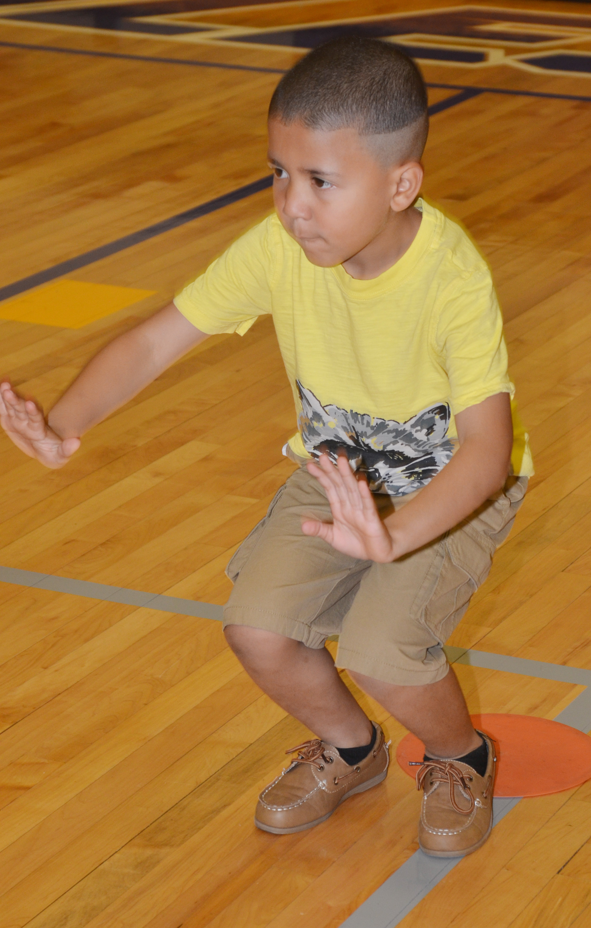 CES first-grader Ahryan Wilson exercises.
