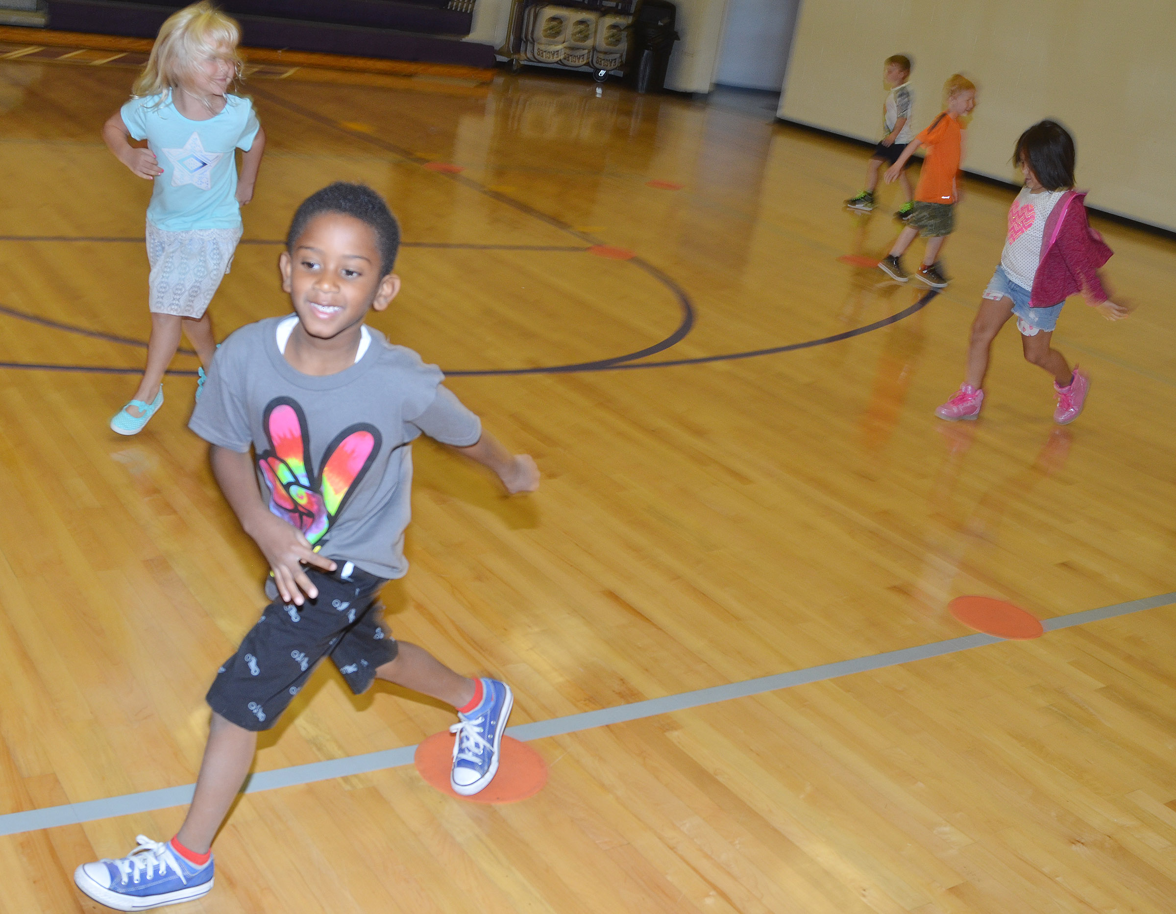 CES first-grader Kasen Smith and his classmates run.