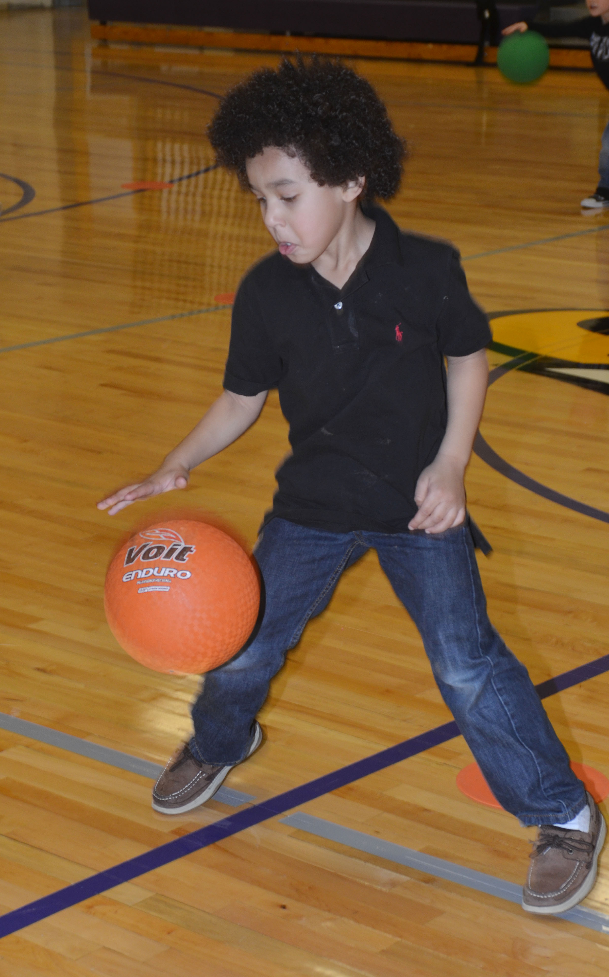 CES kindergarten Travontae Jones practices dribbling in the new CES gymnasium.
