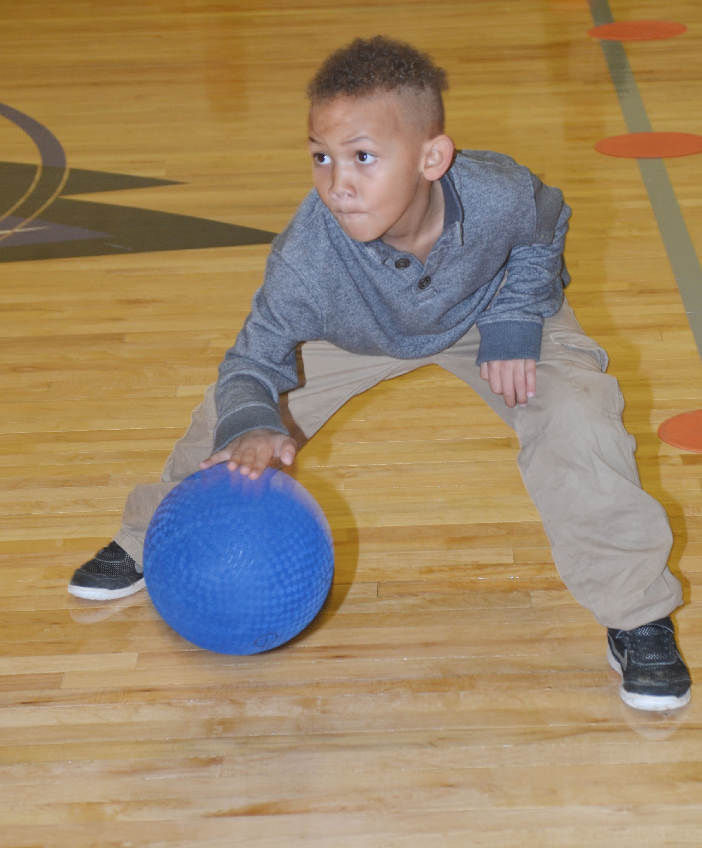 CES kindergartener Treshaun Robinson practices dribbling in the new CES gymnasium.
