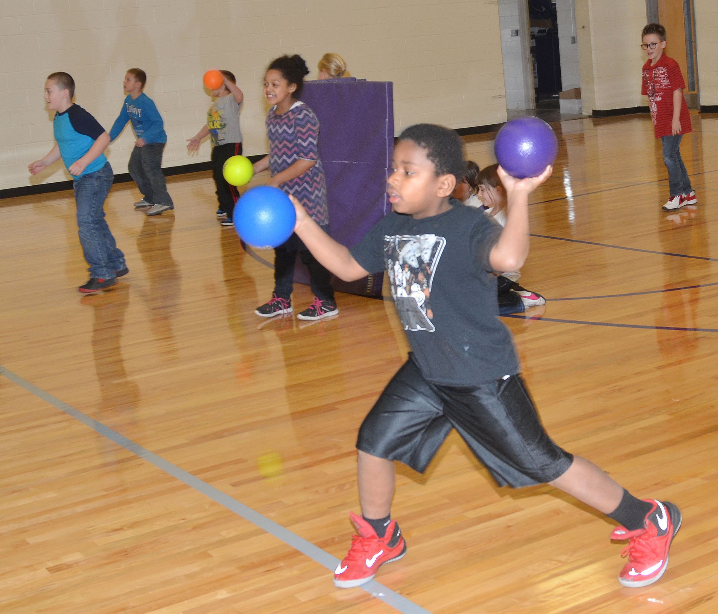 CES second-grader Elijah Spurling throws a dodgeball.