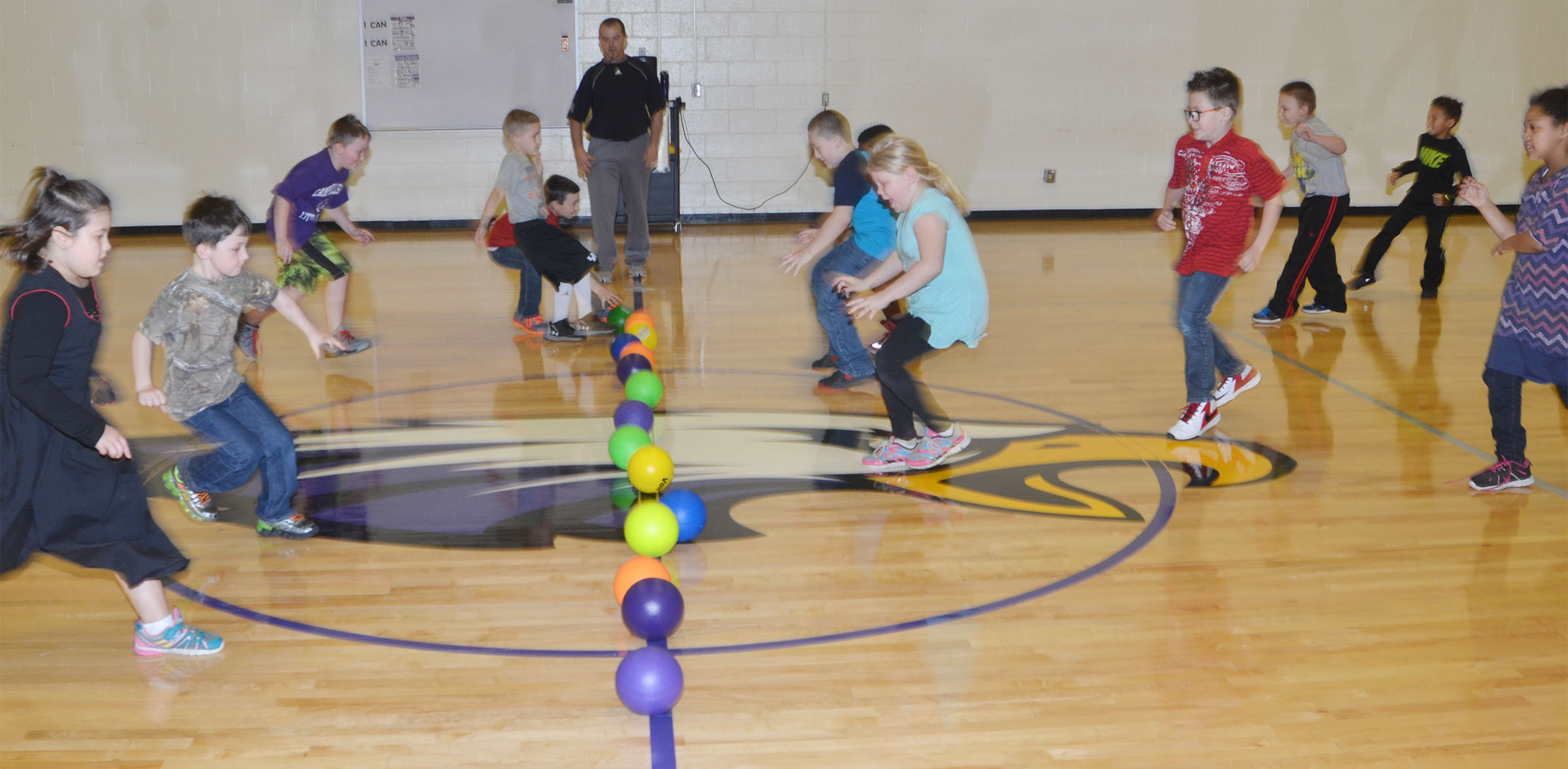 CES second-graders run for the dodgeballs.