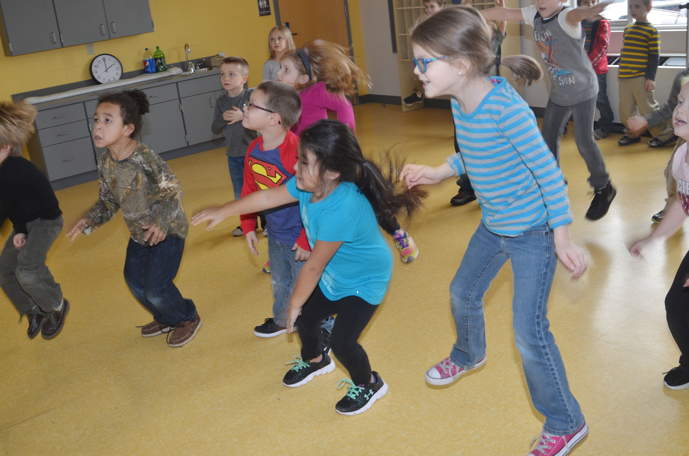 CES kindergartners dance to the music.