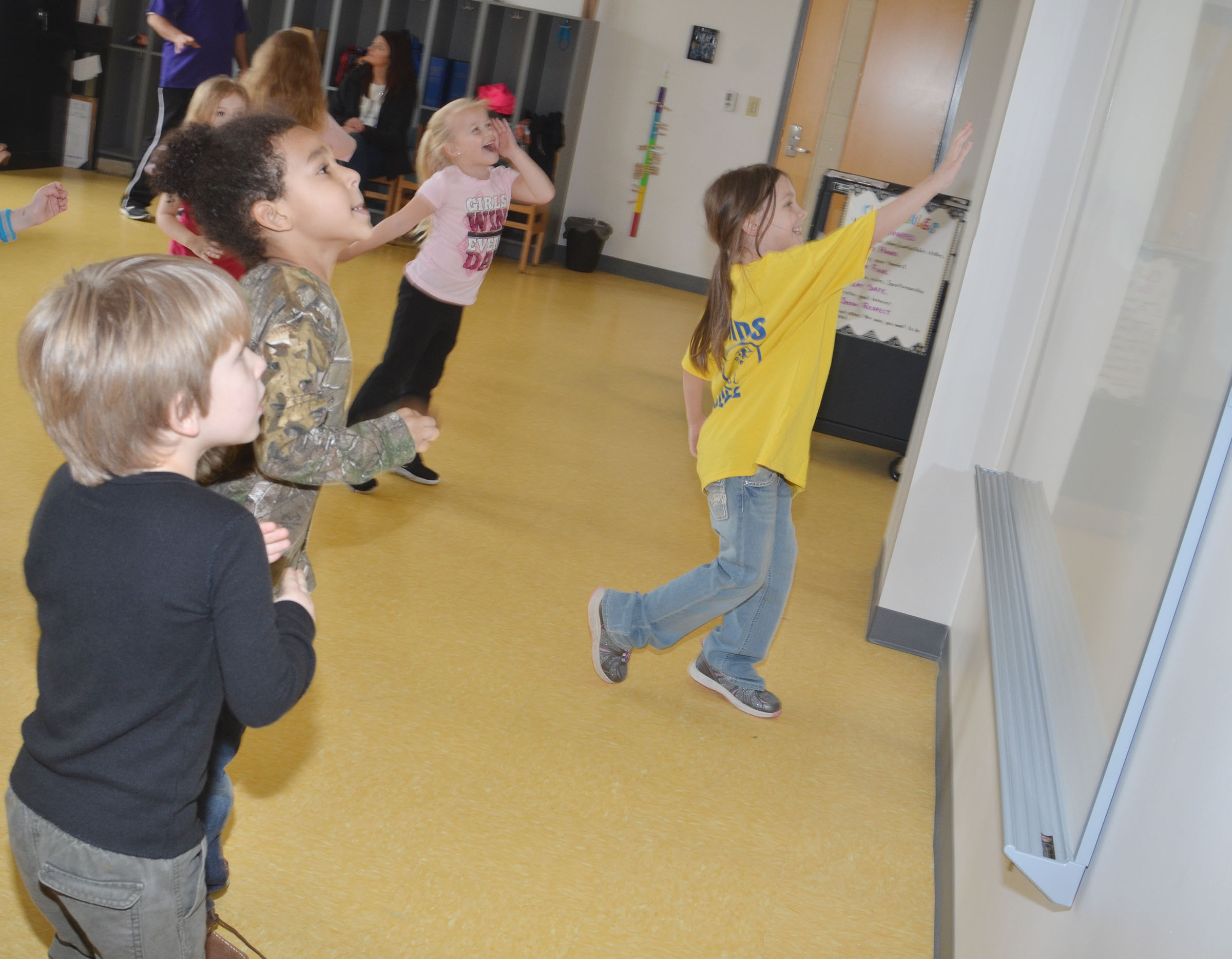 CES kindergartner Melody Ward dances with her classmates.