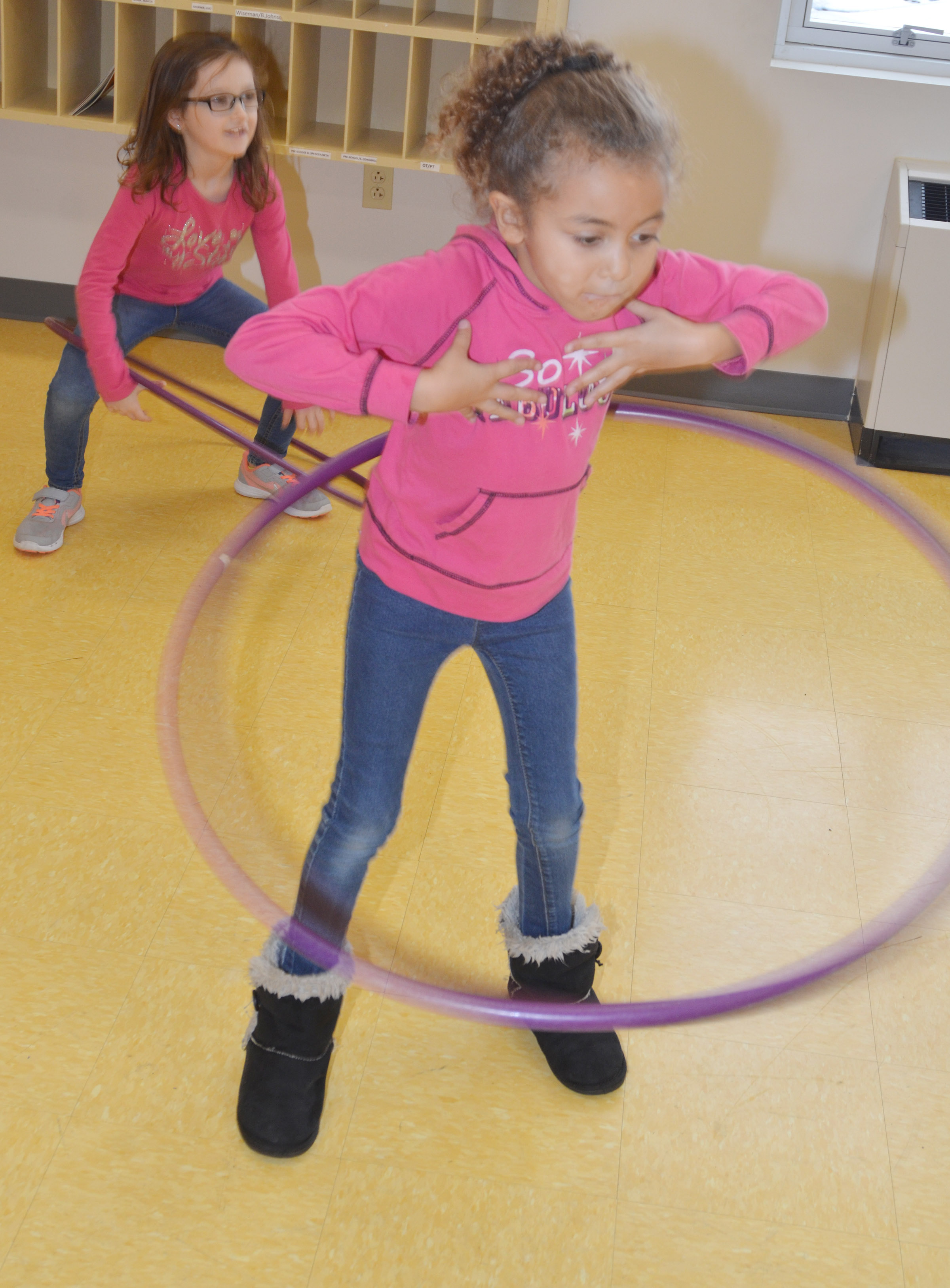 CES first-grader Londyn Smith sees how long she can hula hoop.