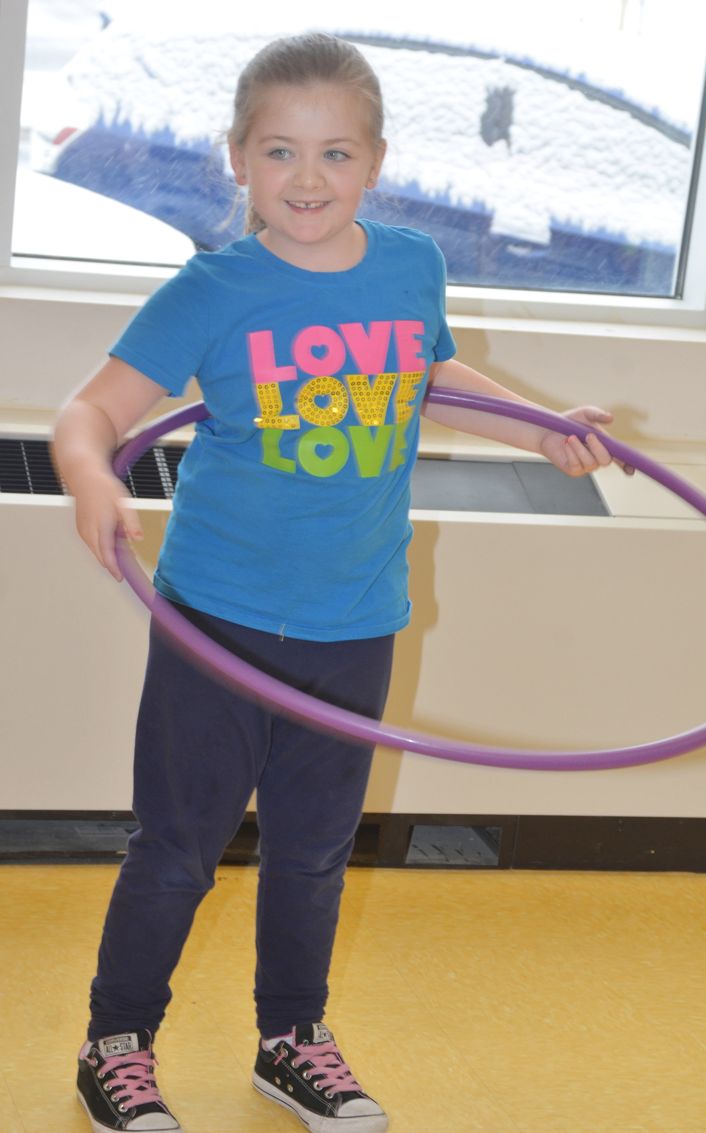 CES first-grader Frehley Whitlow hula hoops.