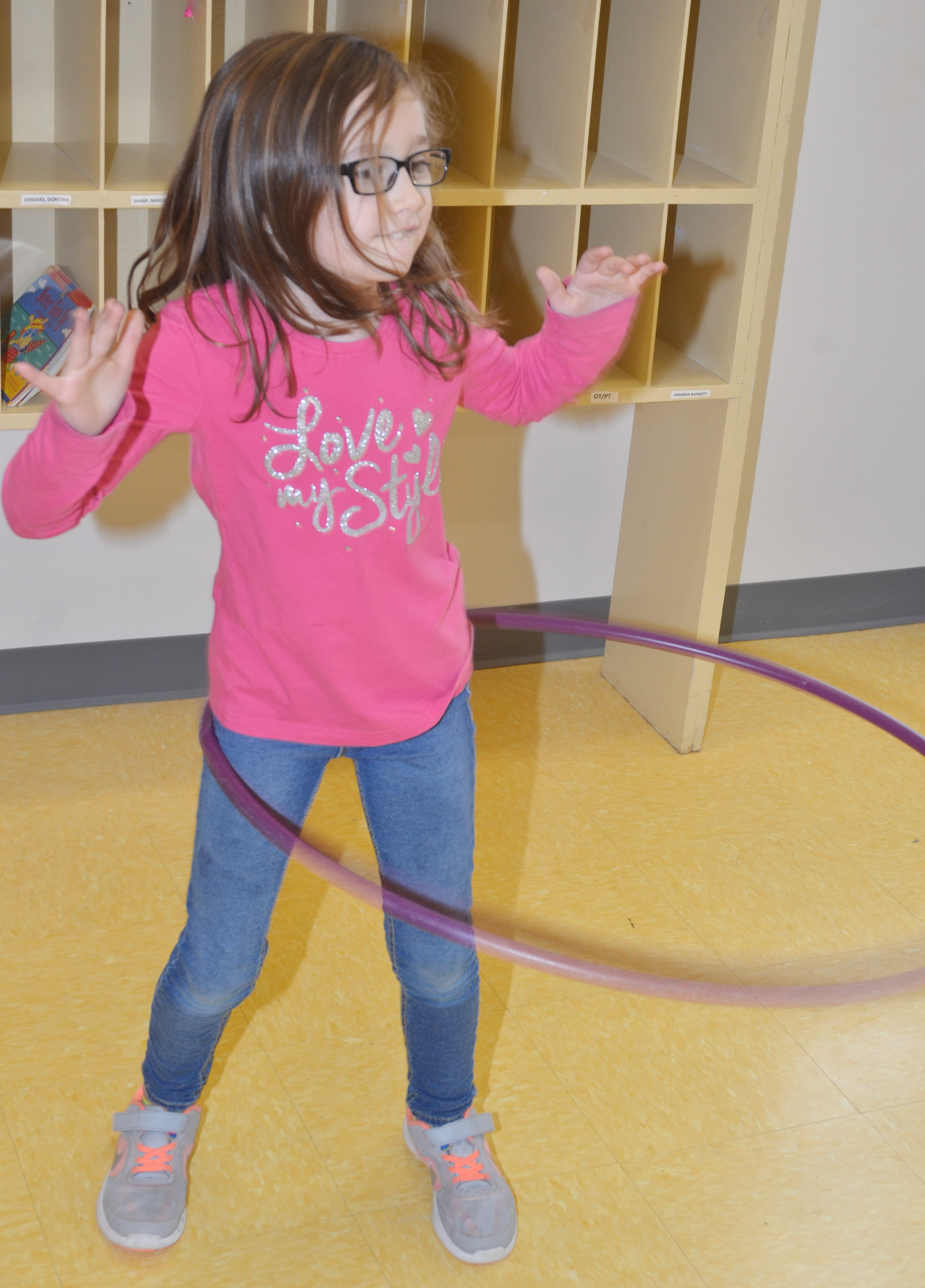 CES first-grader Anna Keith hula hoops.