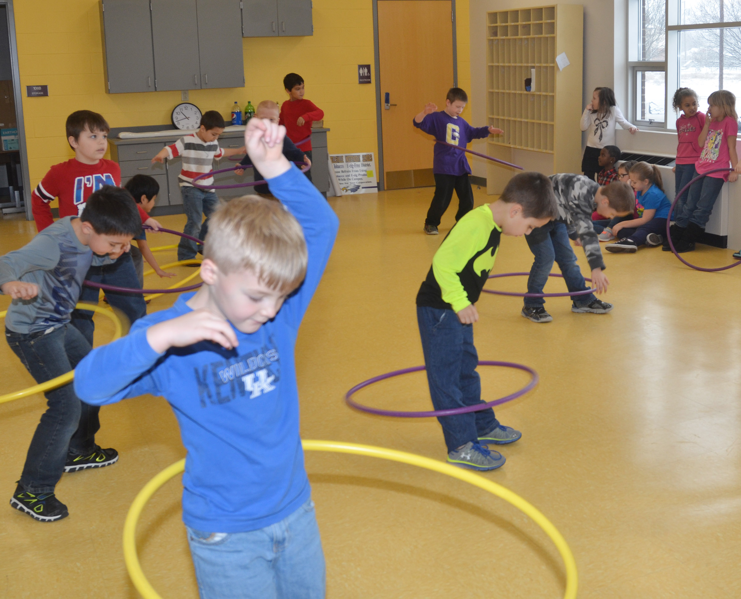 CES first grader Samuel Scharbrough and his classmates see how long they can hula hoop.