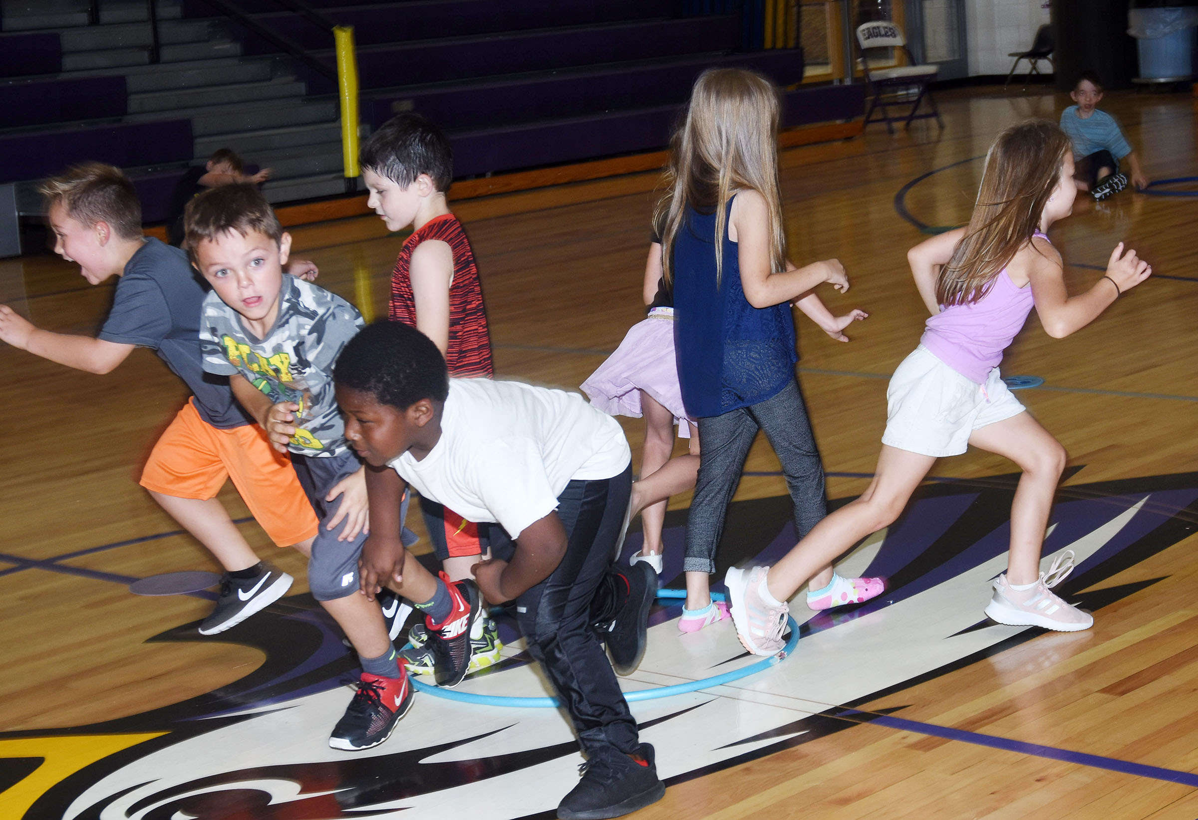 "CES first-graders run from the ""skunk."""