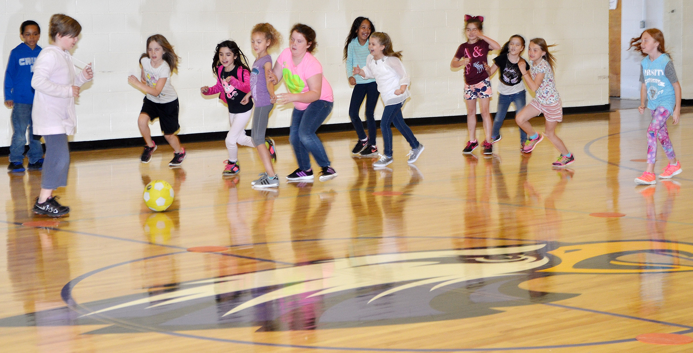 CES third-graders battle for the soccer ball.
