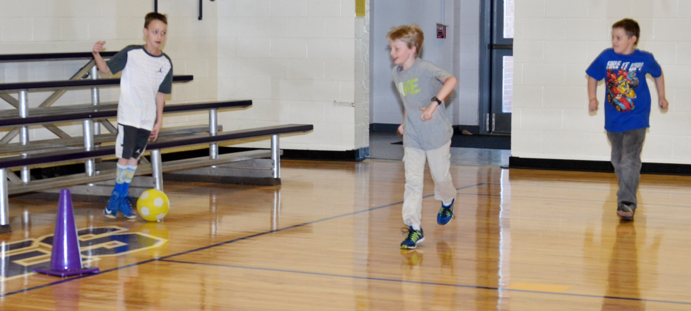 CES third-grader Caysen Tungate kicks the ball.