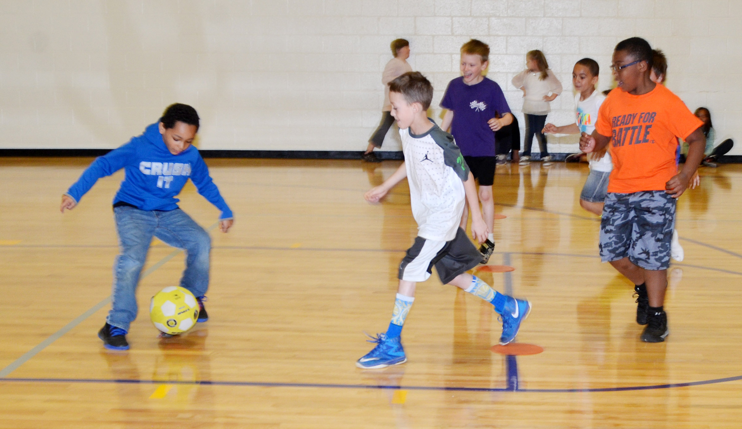 CES third-grader Jalen Embry kicks the ball.