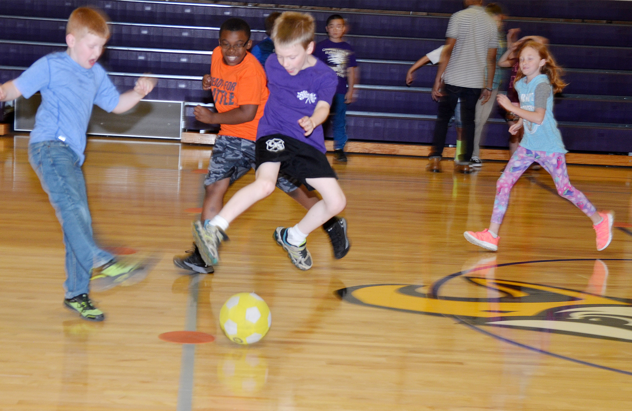 CES third-grader Connor Coots, center, jumps to block the ball.