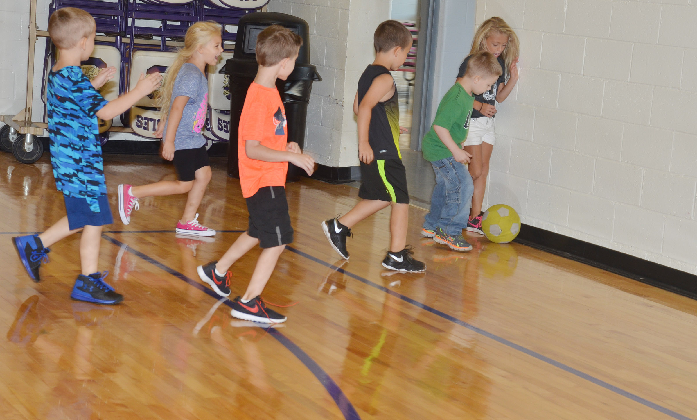 CES first-graders battle for the soccer ball.