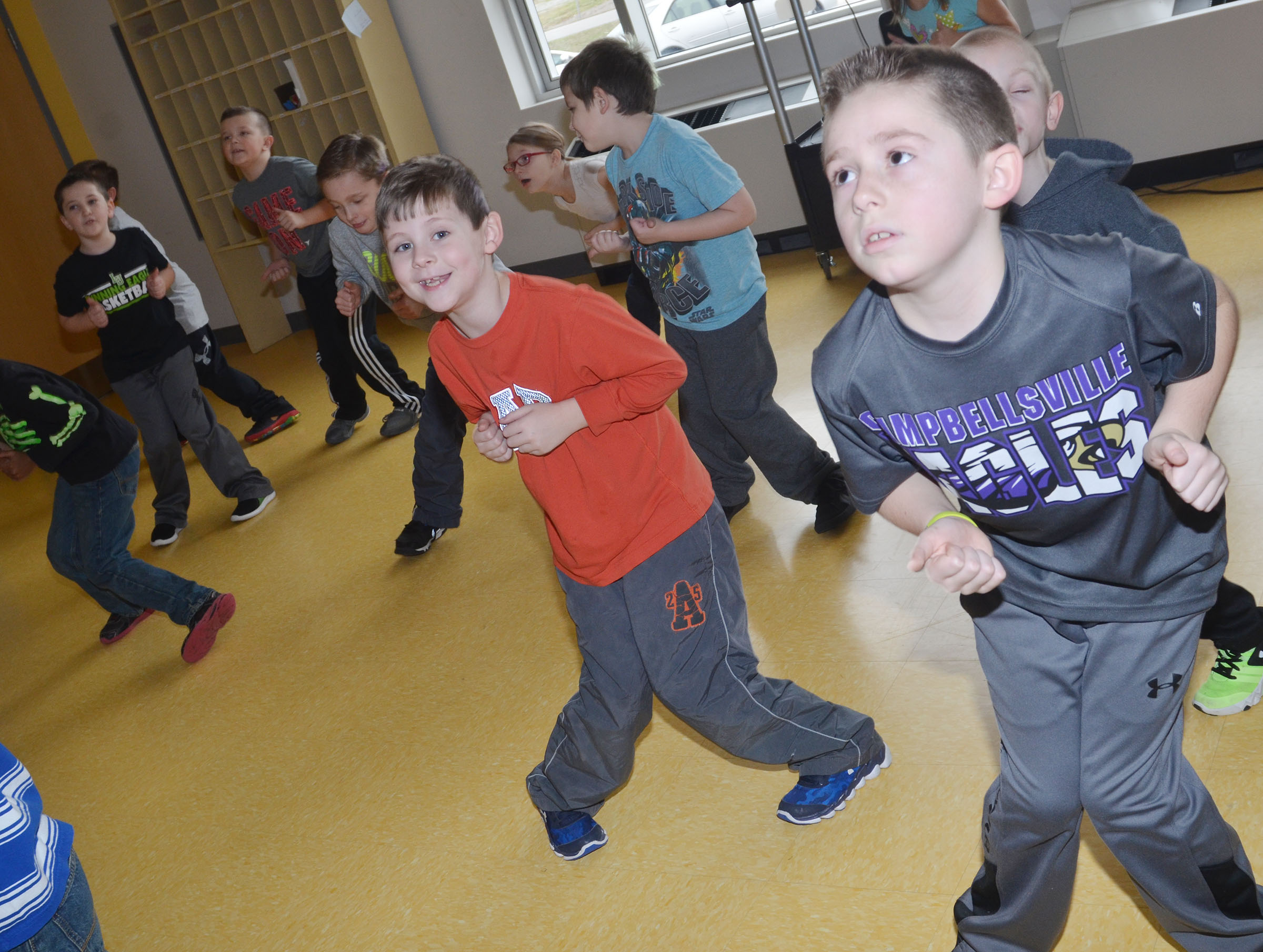 CES second-graders dance as they work out. In front are Ryan Tungate, at left, and Lanigan Price.
