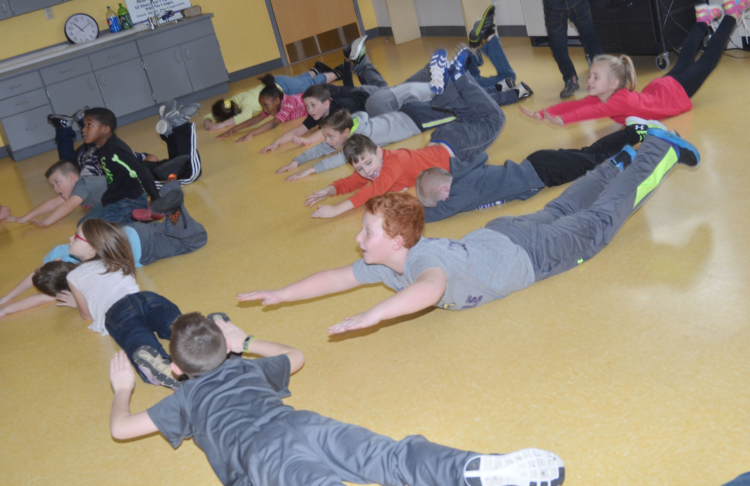 CES second-graders work out with the Sworkit program.