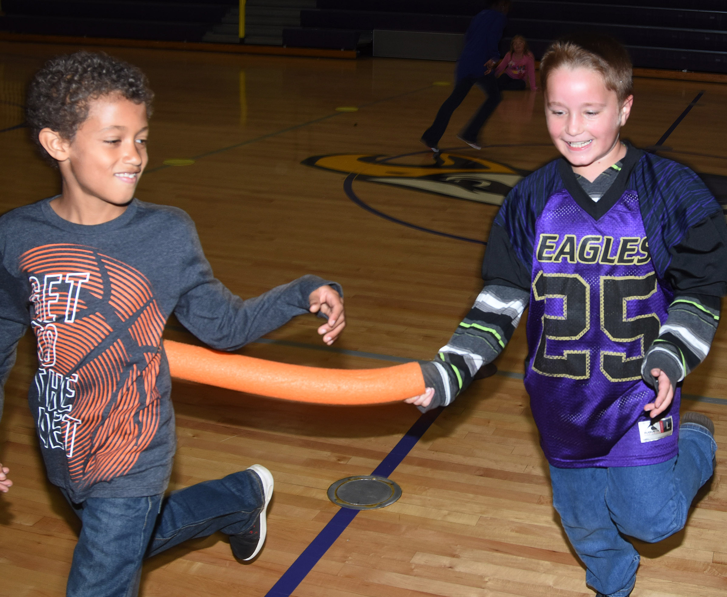 CES second-grader Kaiden Bradfield tags classmate Tyce Owens during a game of zombie tag.