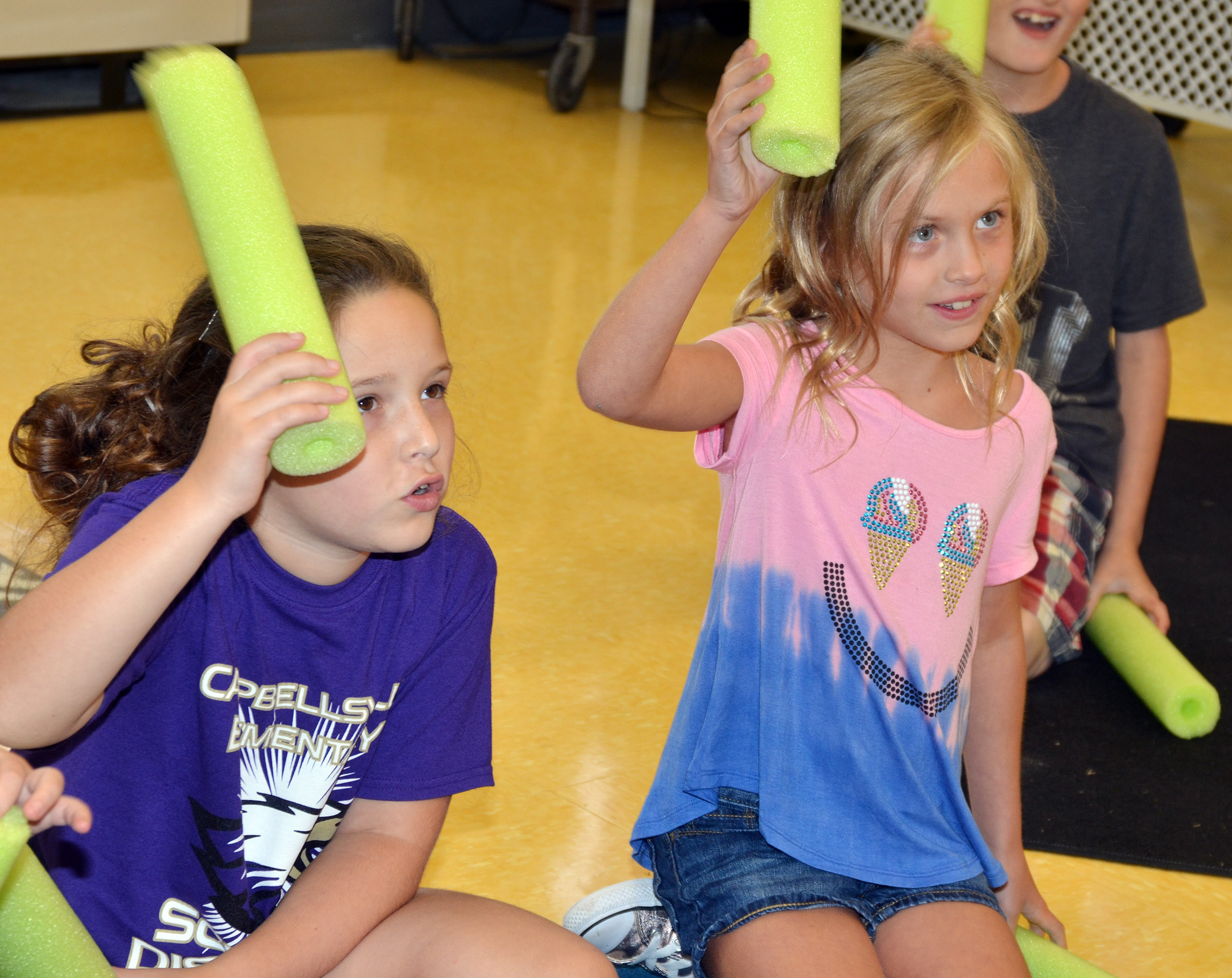 CES second-graders Keely Rakes, at left, and Ava Ellis play a rhythm with pool noodles.