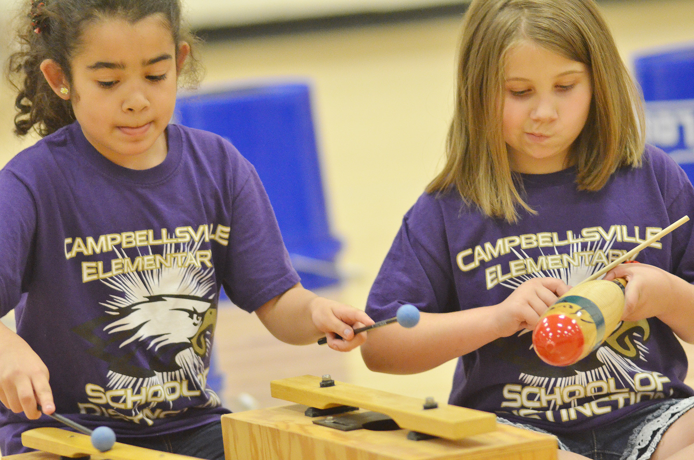 CES second-graders Sophia Santos, at left, and Natalie West play.