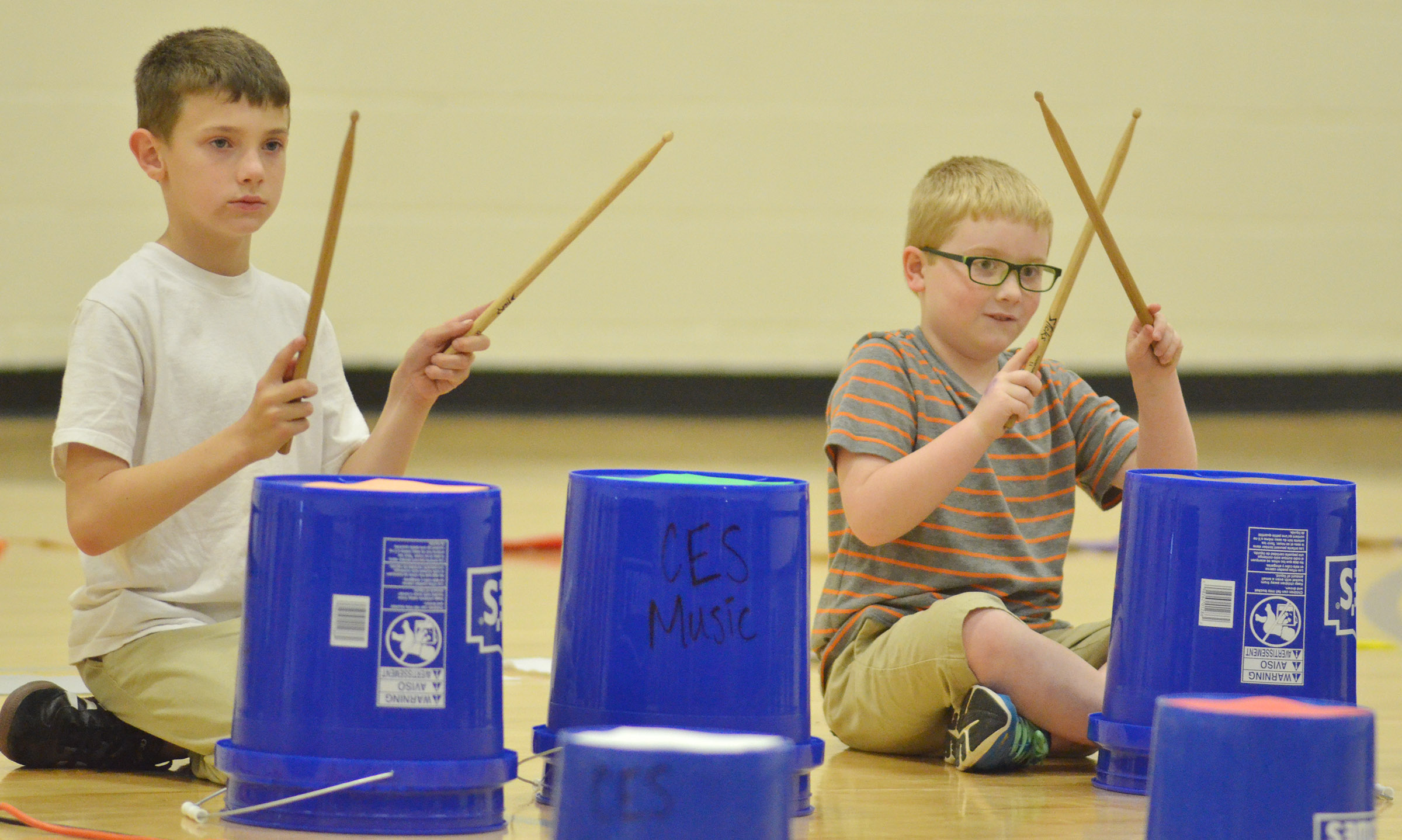 CES second-graders Aidan Wilson, at left, and Aidan Bowles keep the beat.