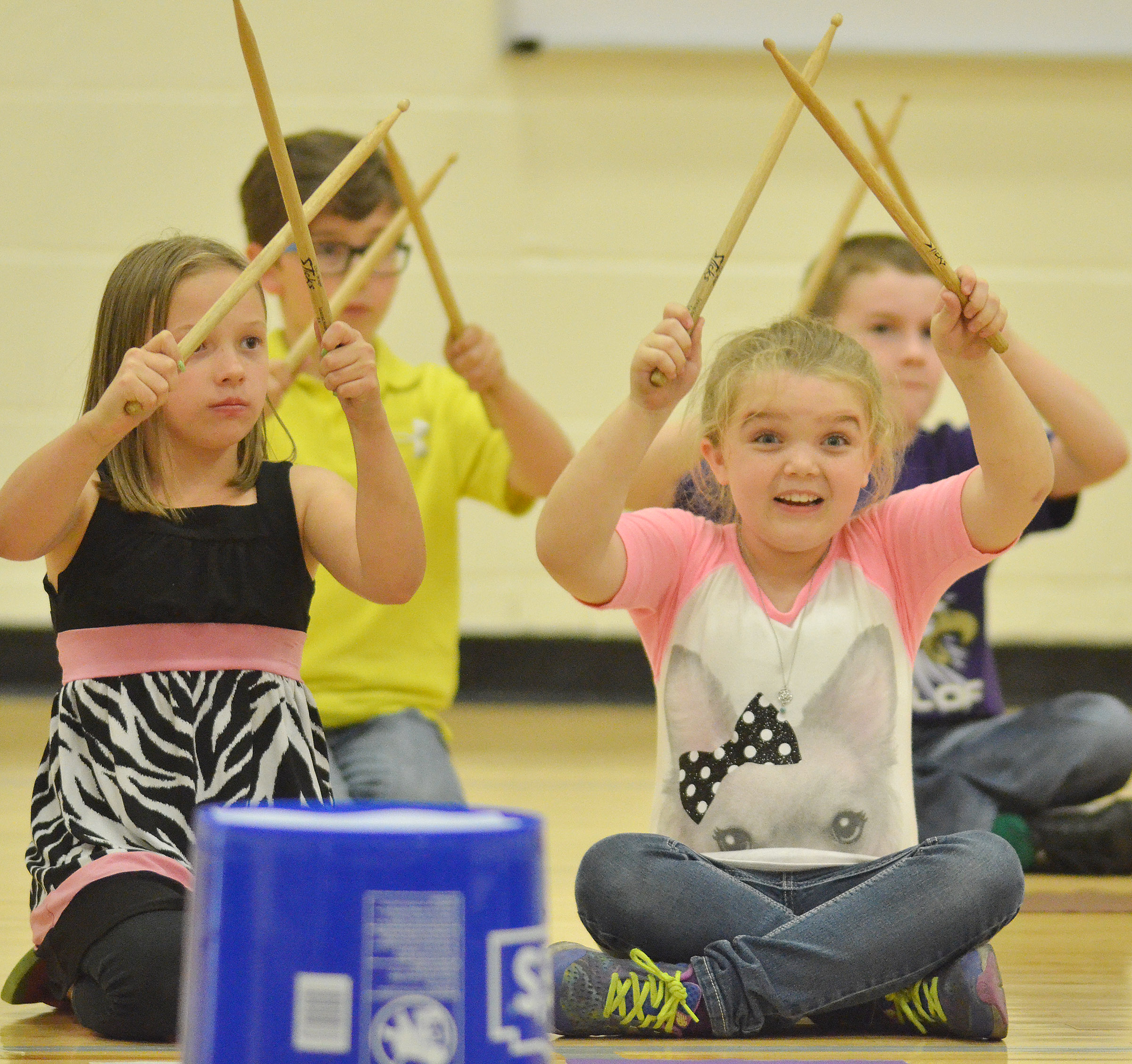 CES second-grader Jaylin Christie smiles as she and her classmates keep the beat.