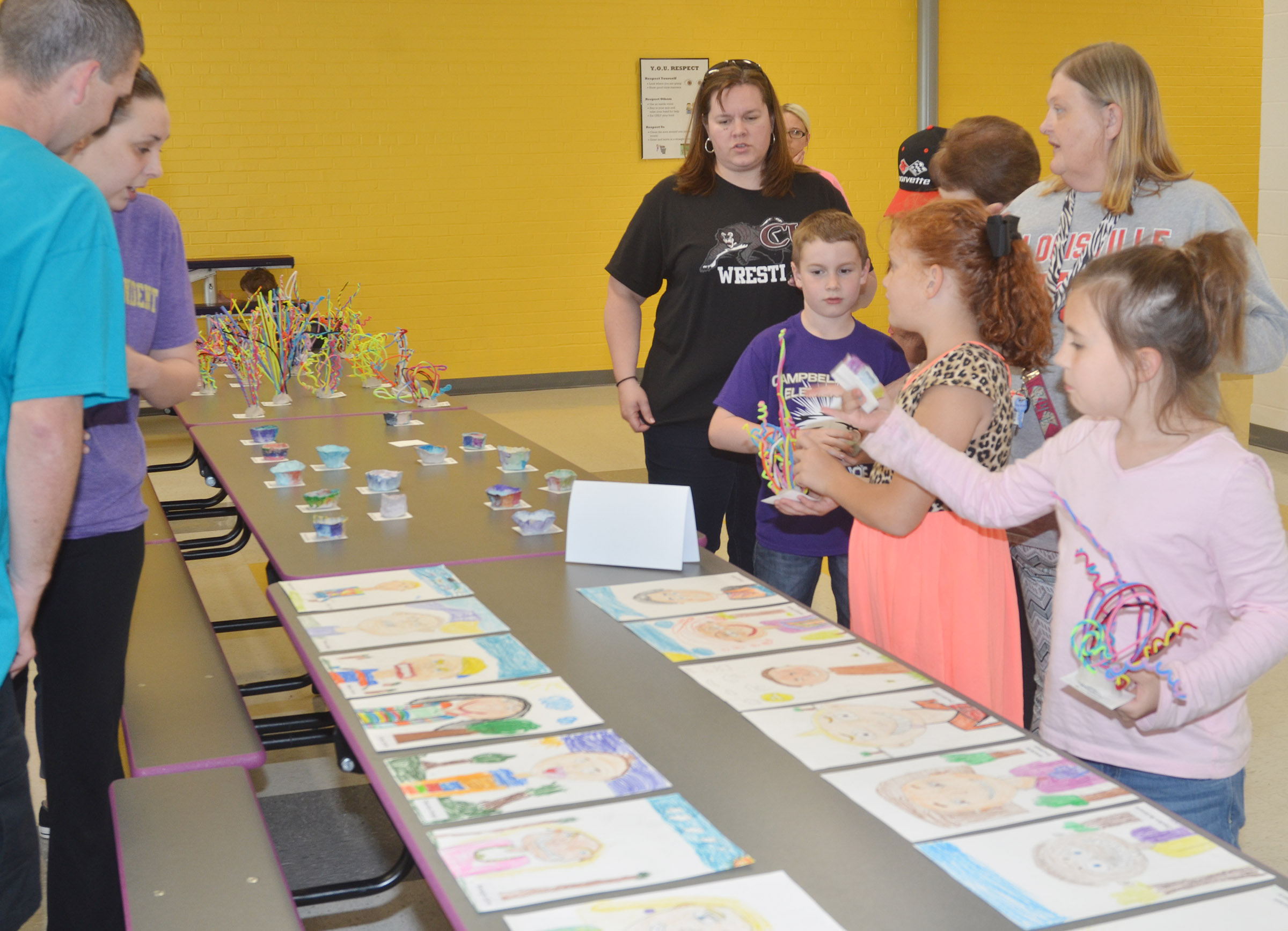CES second-graders show the artwork they made in Adrienne Hash's class.