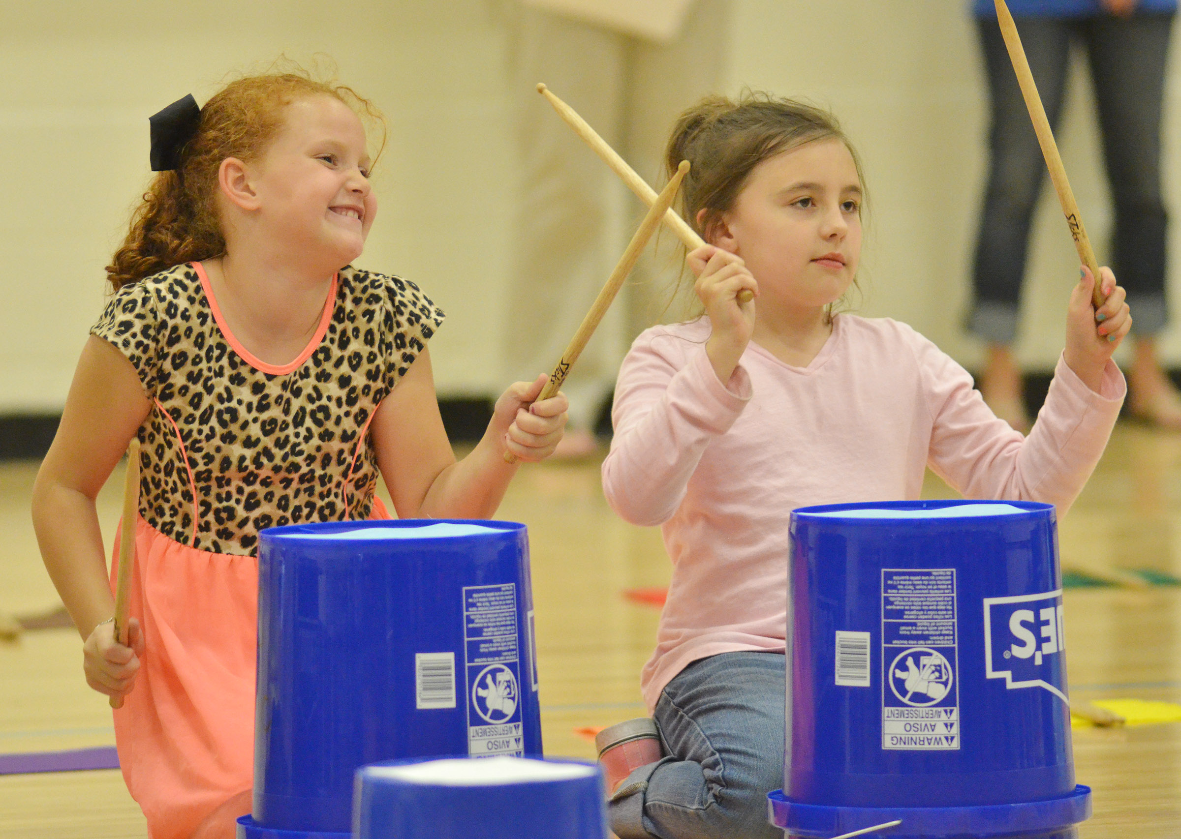 CES second-graders Analeigh Foster, at left, and Annabelle Brockman keep the rhythm.