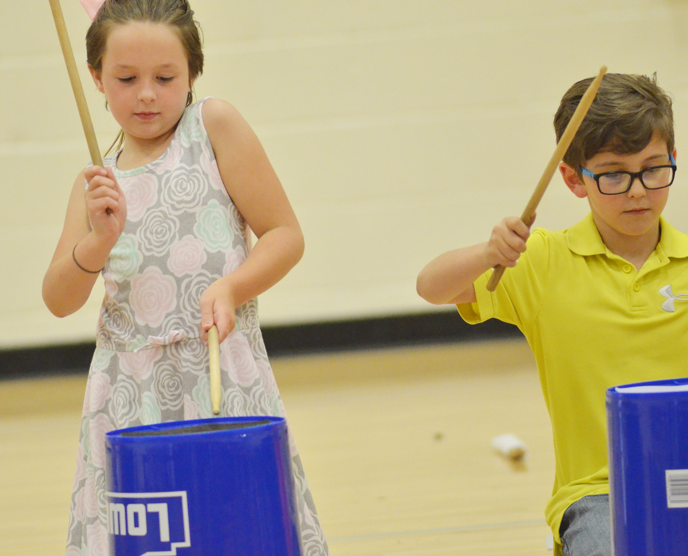 CES second-graders Evelyn Stancill, at left, and Tye Rhodes keep the beat.