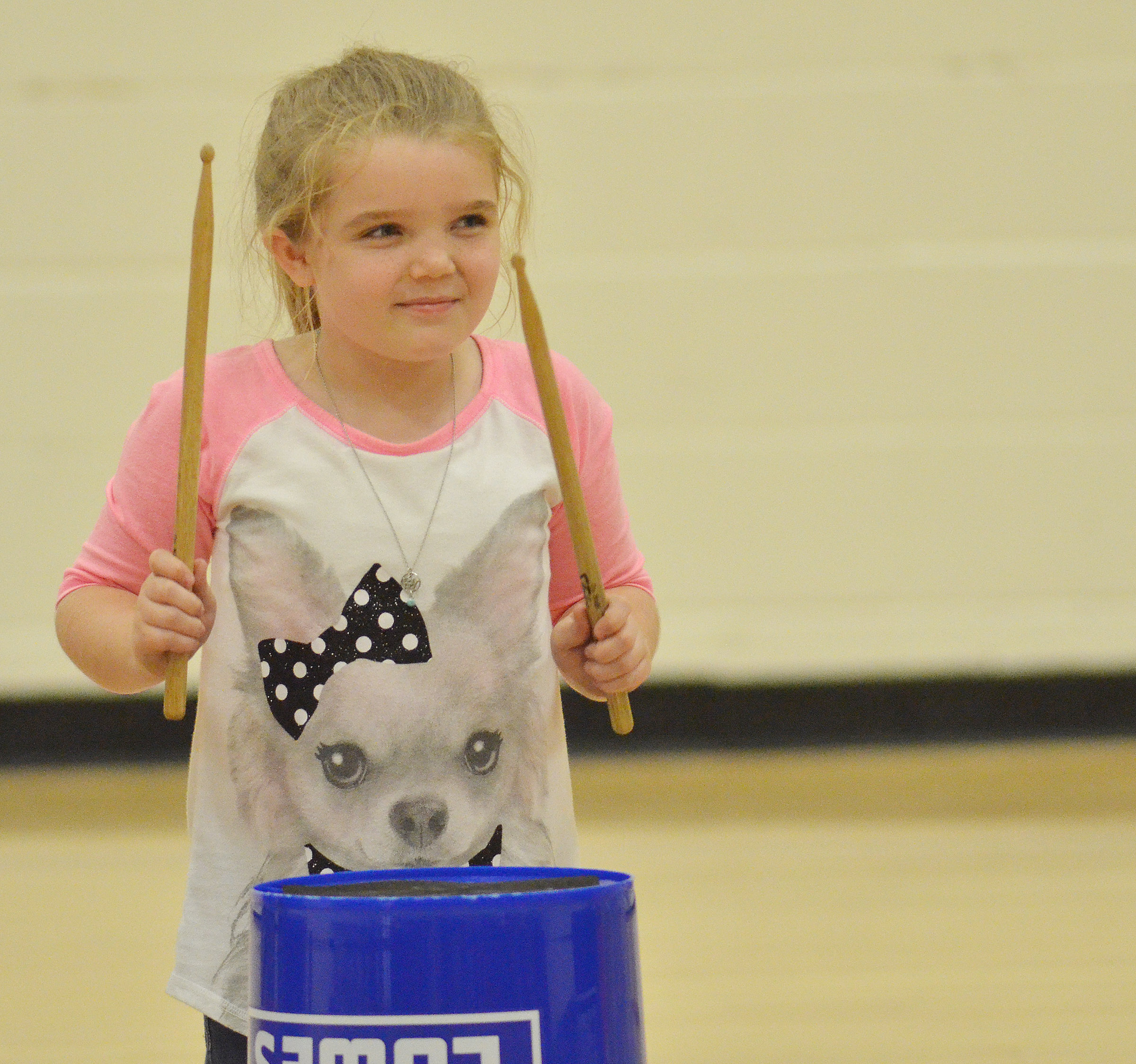 CES second-grader Jaylin Christie plays the bucket drums.