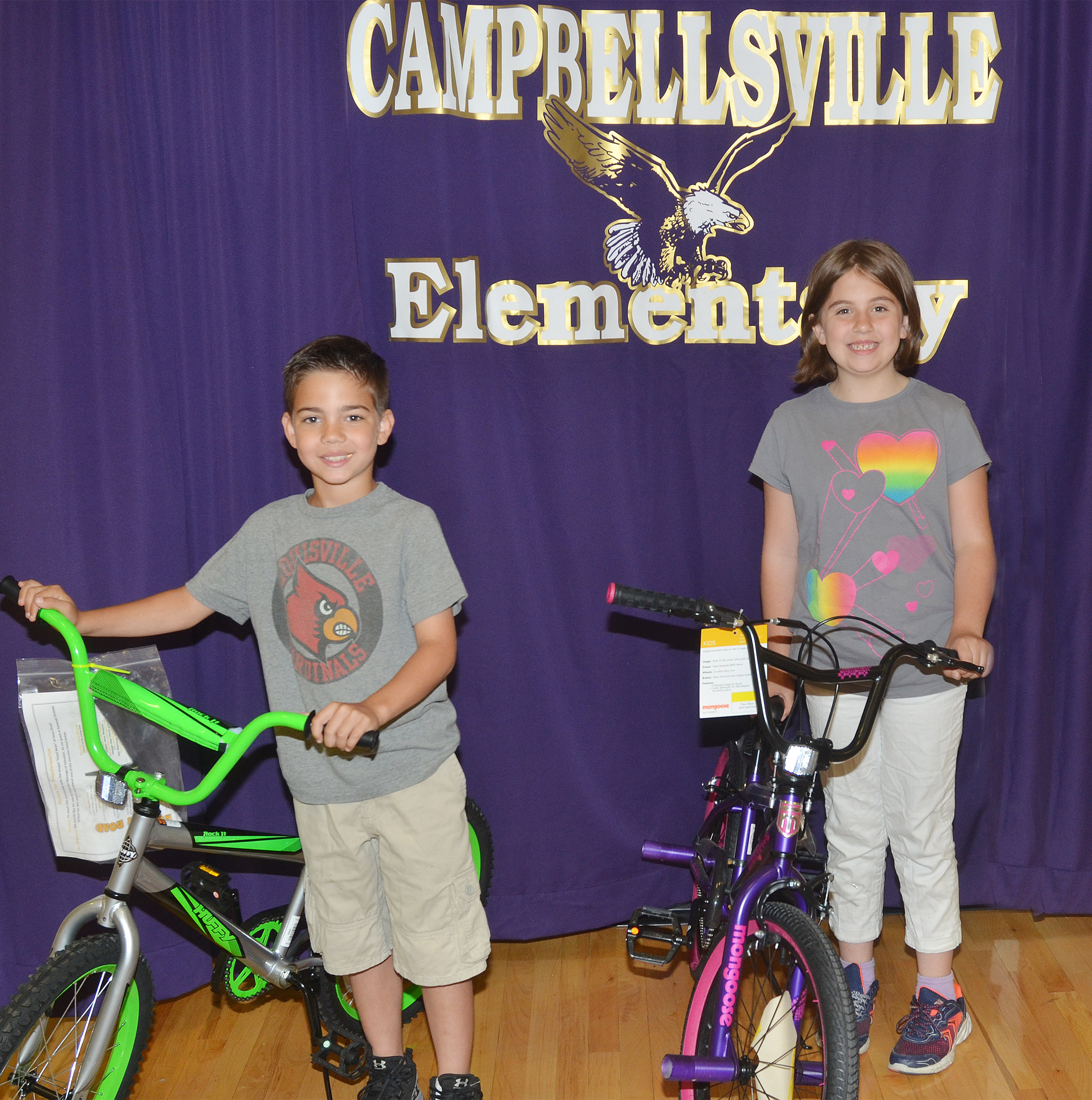 Campbellsville Elementary School third-graders Easton Williams, at left, and Adrianna Garvin have received bicycles for having perfect attendance this school year. Pitman Masonic Lodge #124 F&AM members in Campbellsville donated the bicycles.