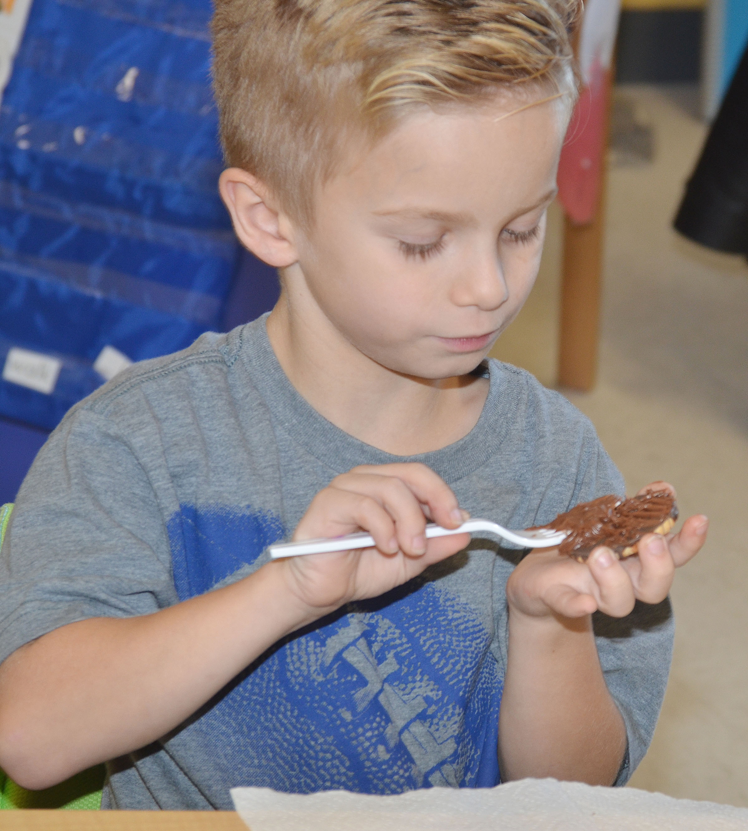 CES first-grader Parker Hamilton adds icing to his cookie.