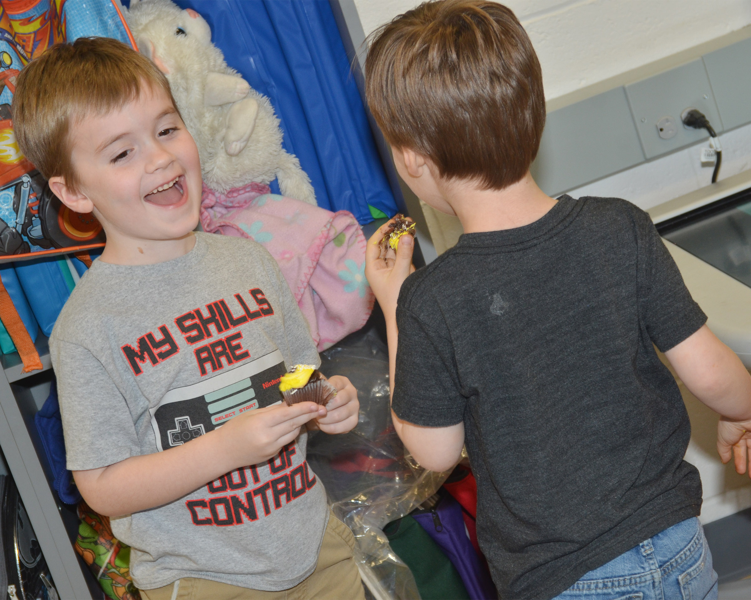 CES kindergartener Gavin Williams enjoys a birthday cupcake with his brother Finley, a preschool student.