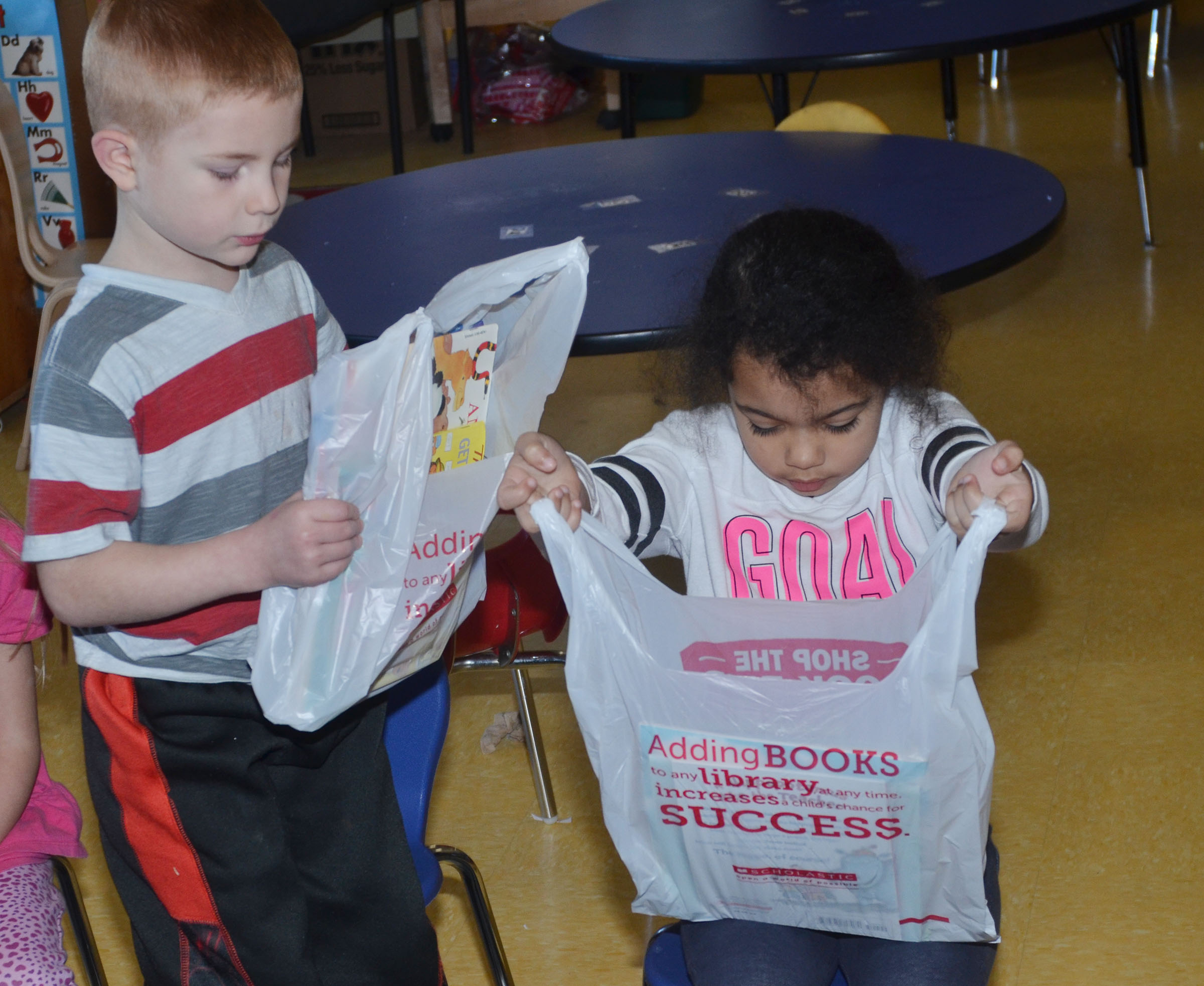CES preschool students Kennon Dotson, at left, and Rylee Karr look at their books.
