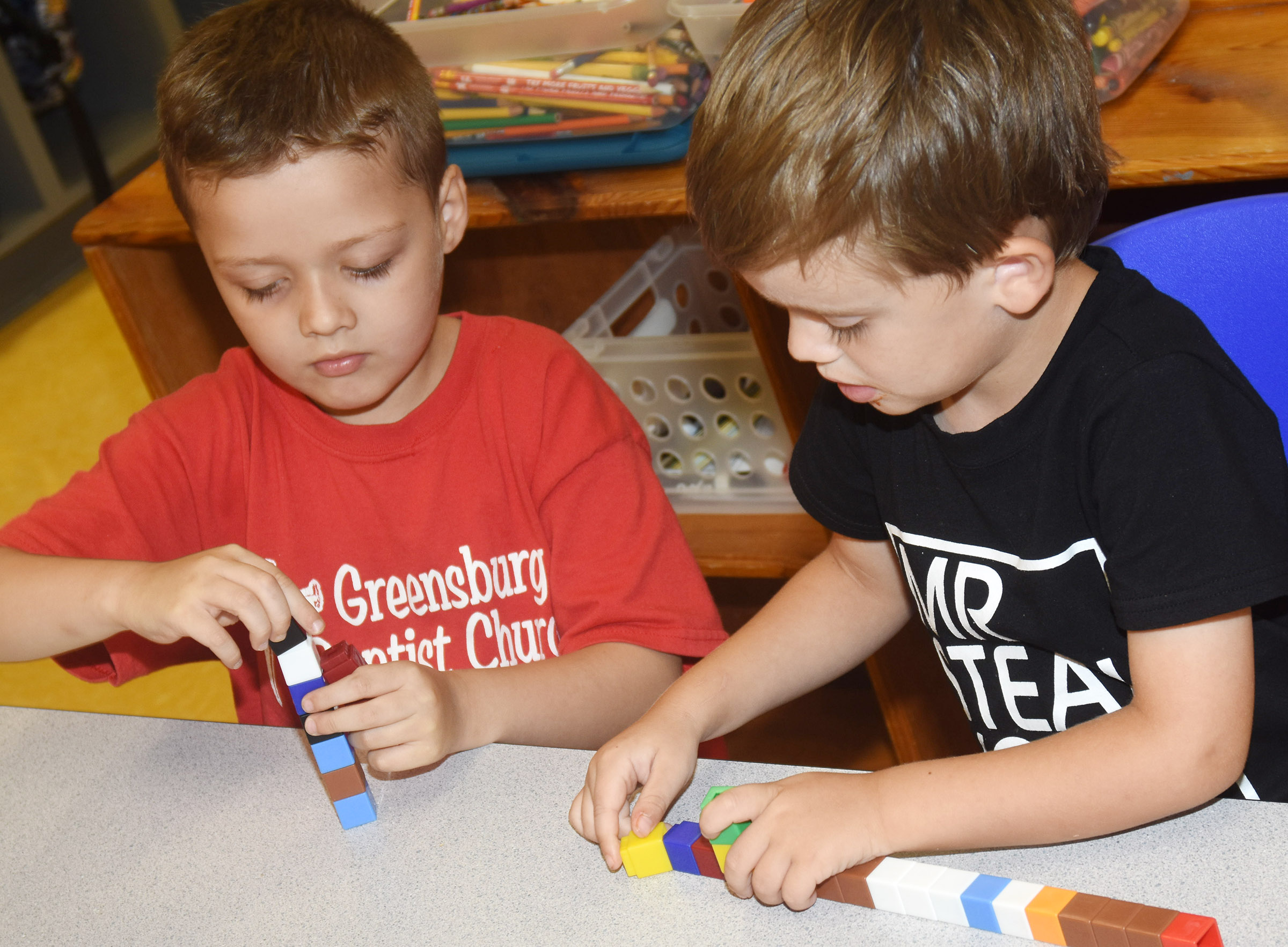 CES preschool students Alex Spurling, at left, and Caleb Tucker build with blocks.