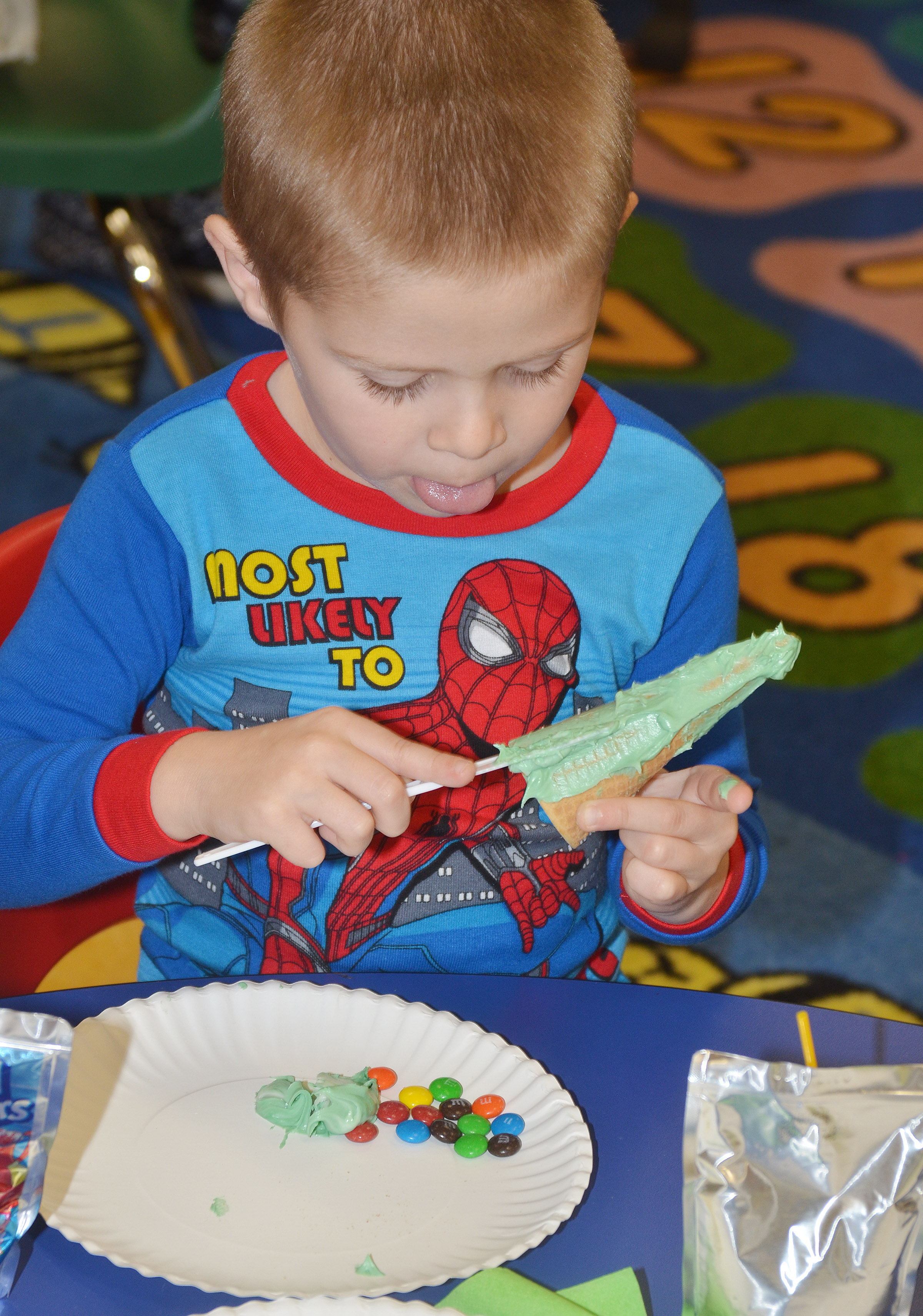 CES preschool student Brian Daniels decorates his edible Christmas tree.