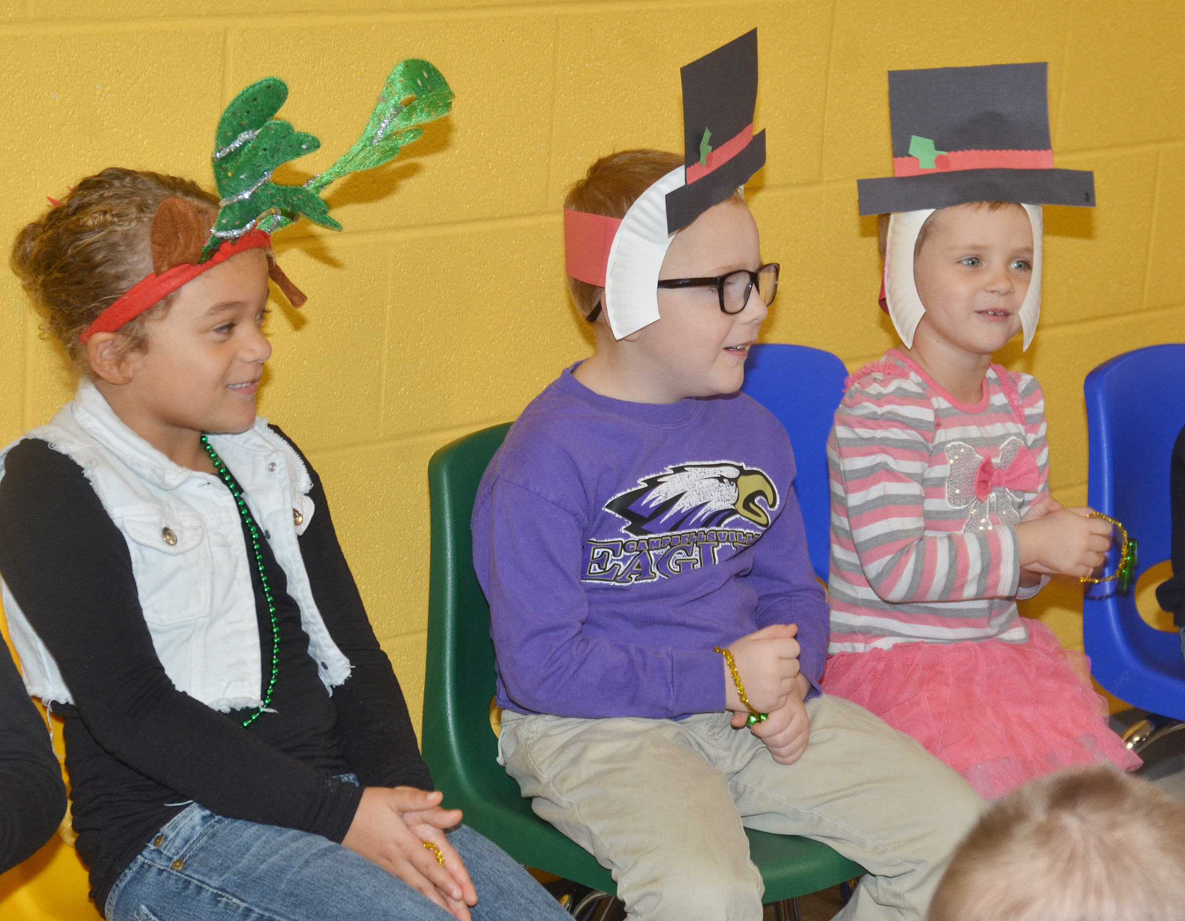 From left, CES preschool students Layla Barbee, Anthony McClure and Elliana Morton sing Christmas songs.