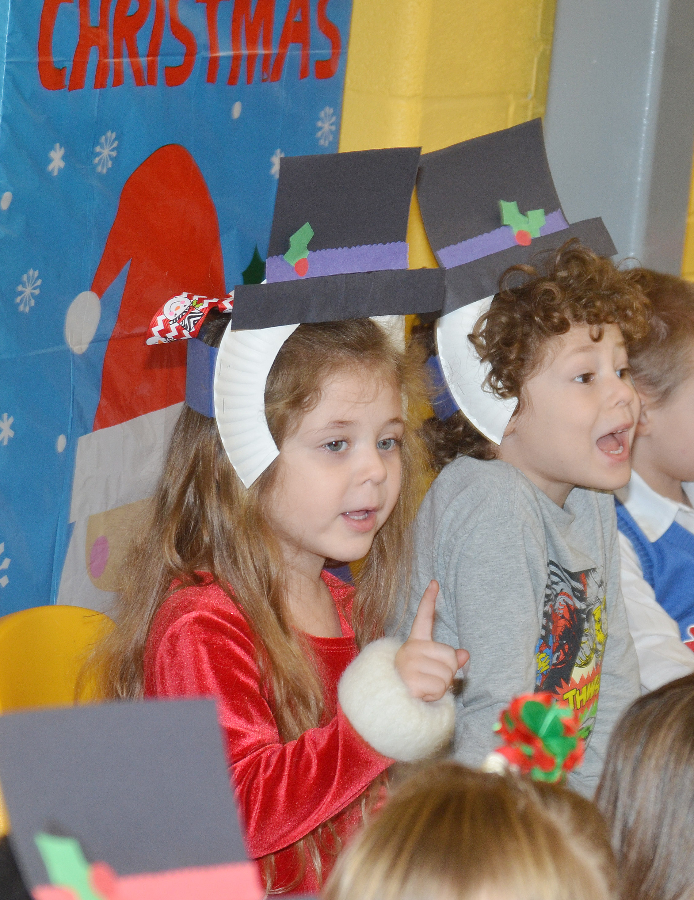 CES preschool students Mila Moss, at left, and Zyron Young sing Christmas songs.
